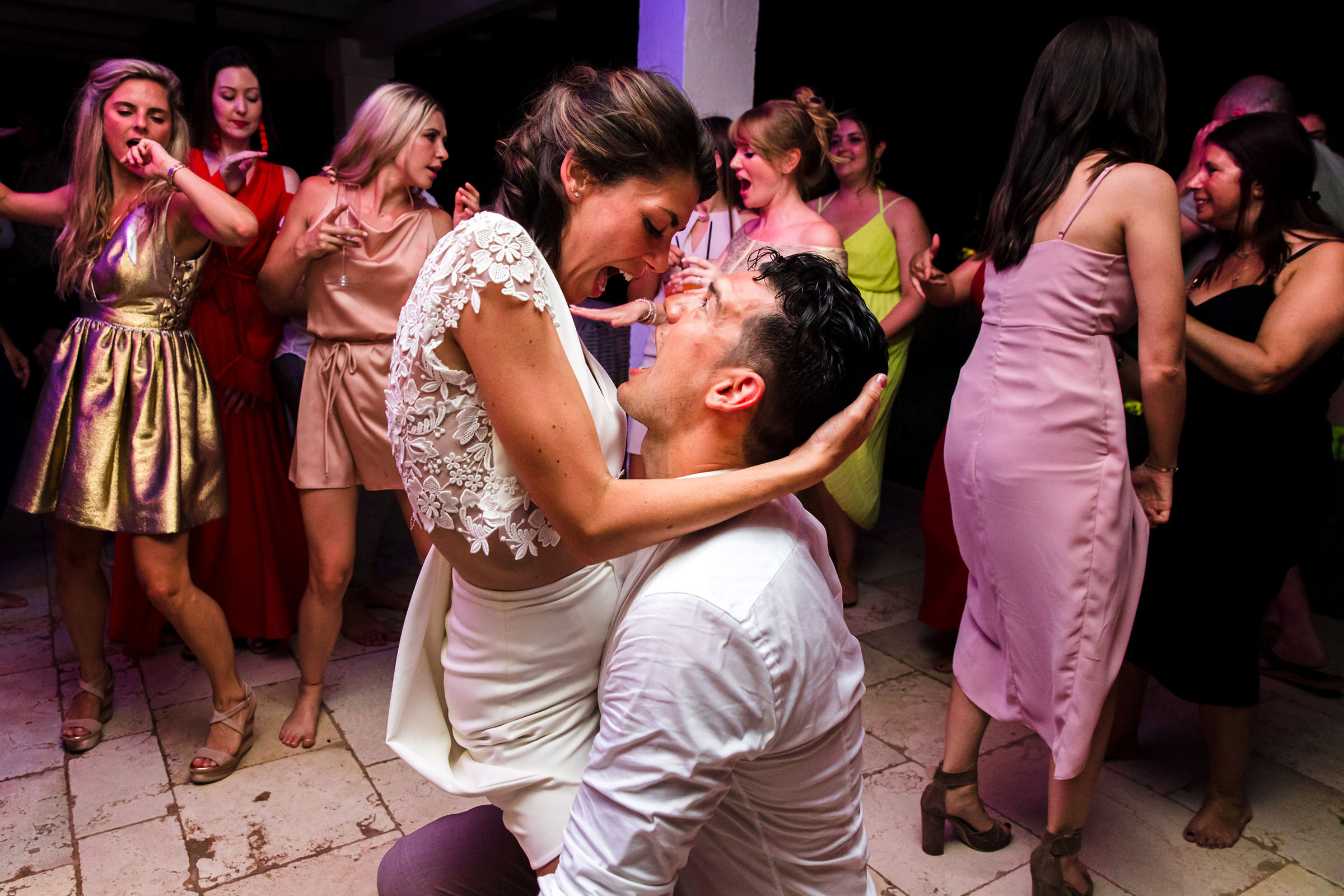 Bride and groom embrace on dancefloor, photo by Philippe Swiggers