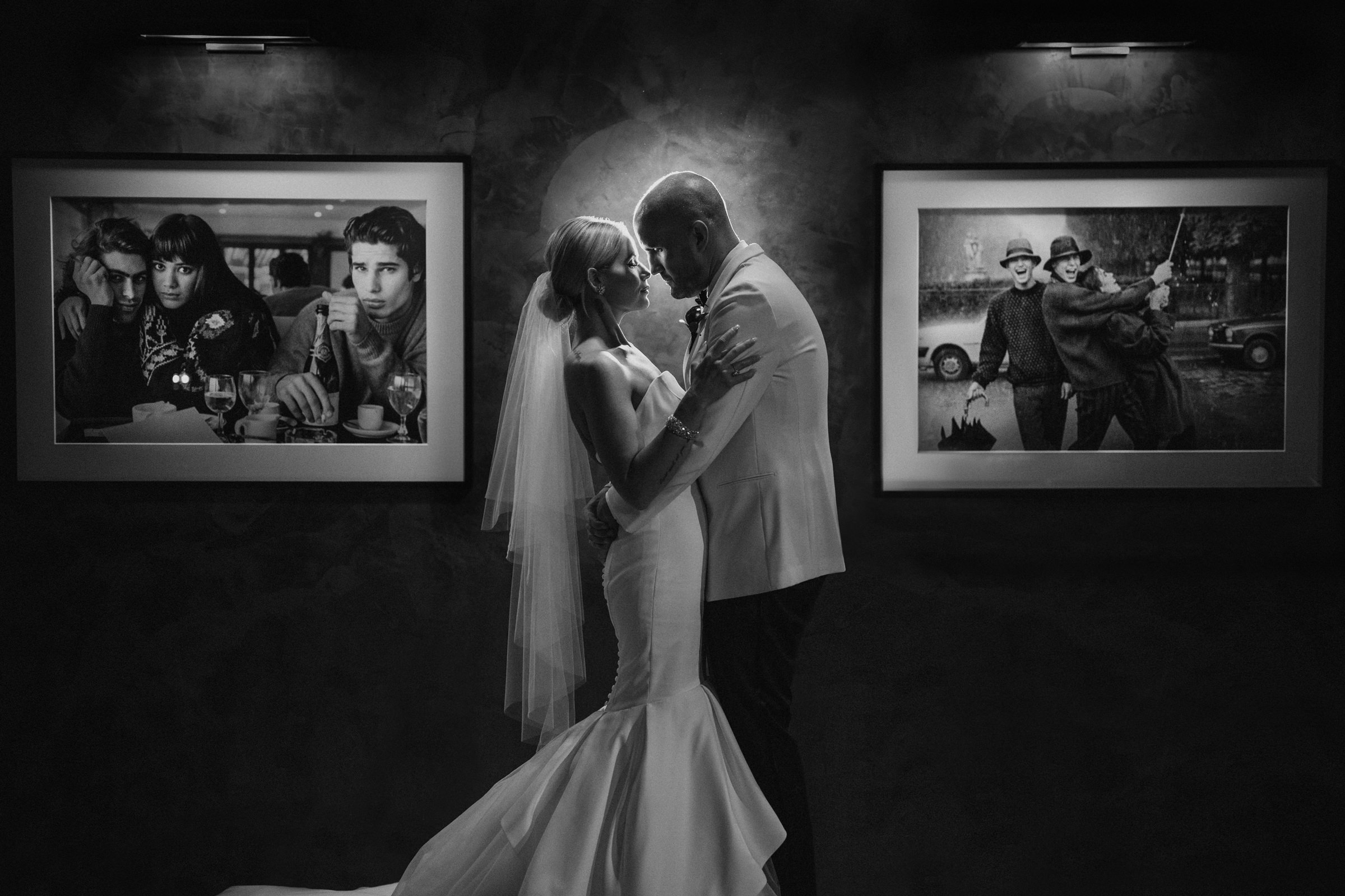 Bride and groom face to face amidst photos - Photo by Susan Stripling Photography