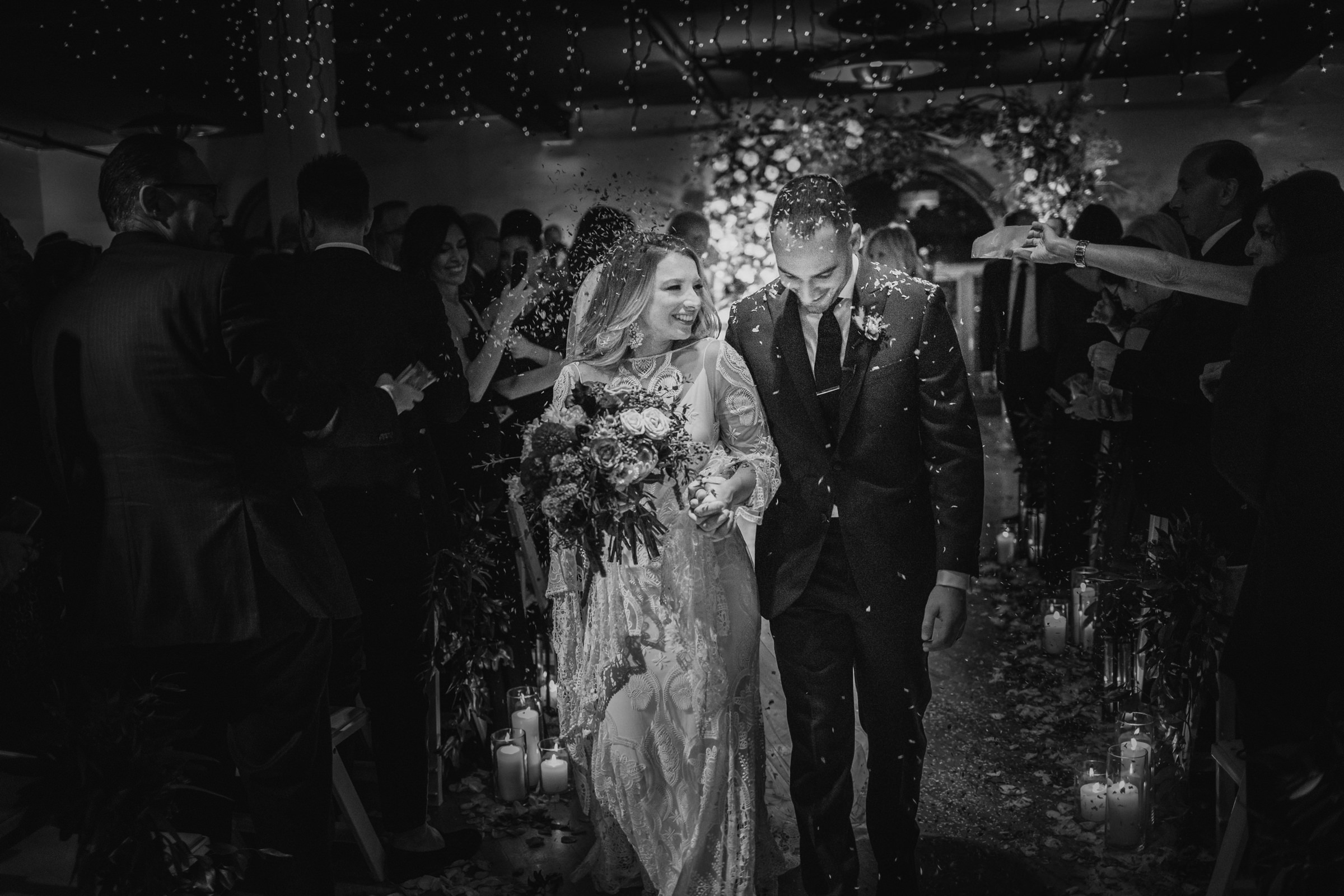 Bride and groom in confetti exit - Photo by Susan Stripling Photography