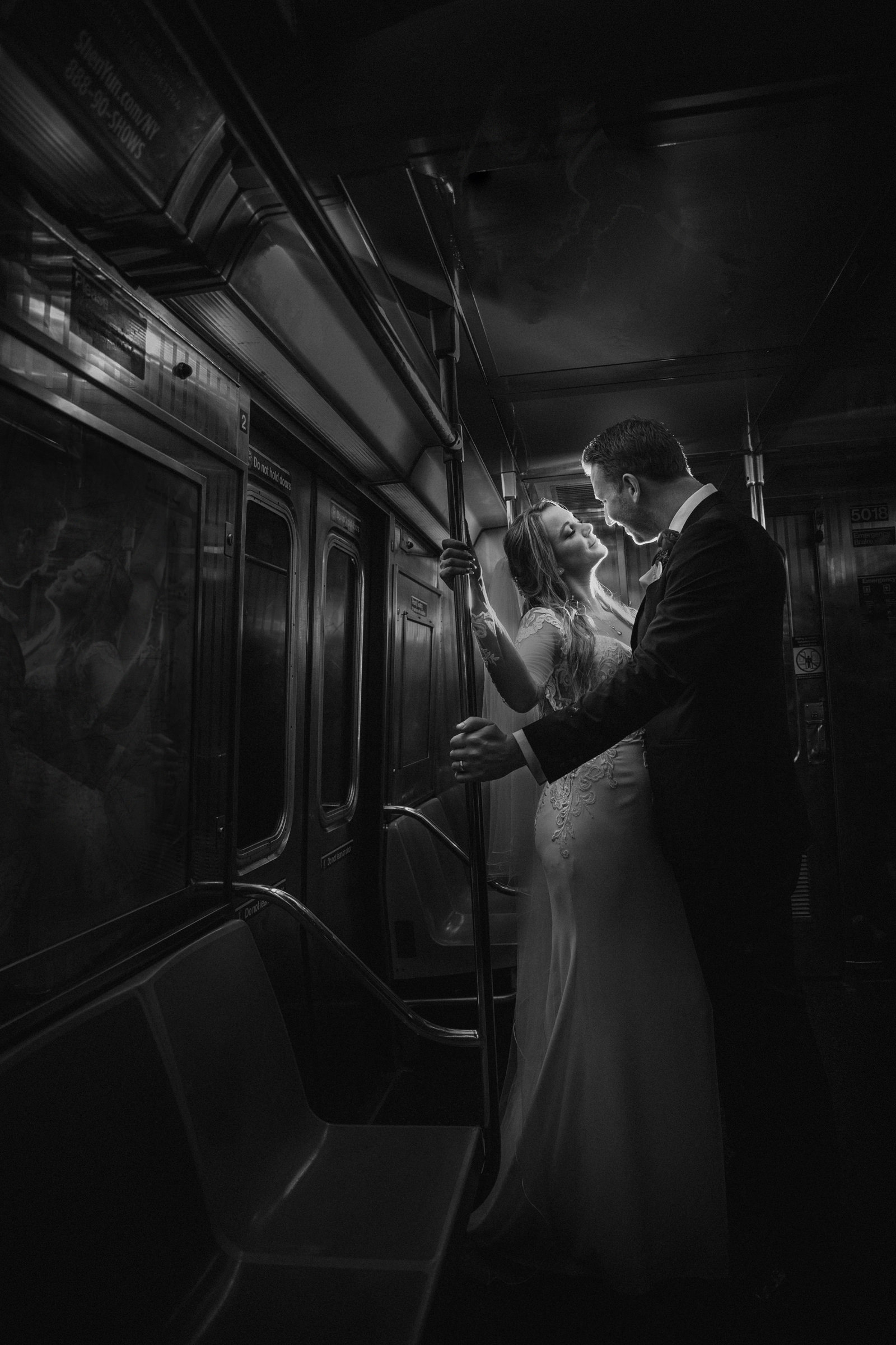 Bride and groom on the subway - Photo by Susan Stripling Photography