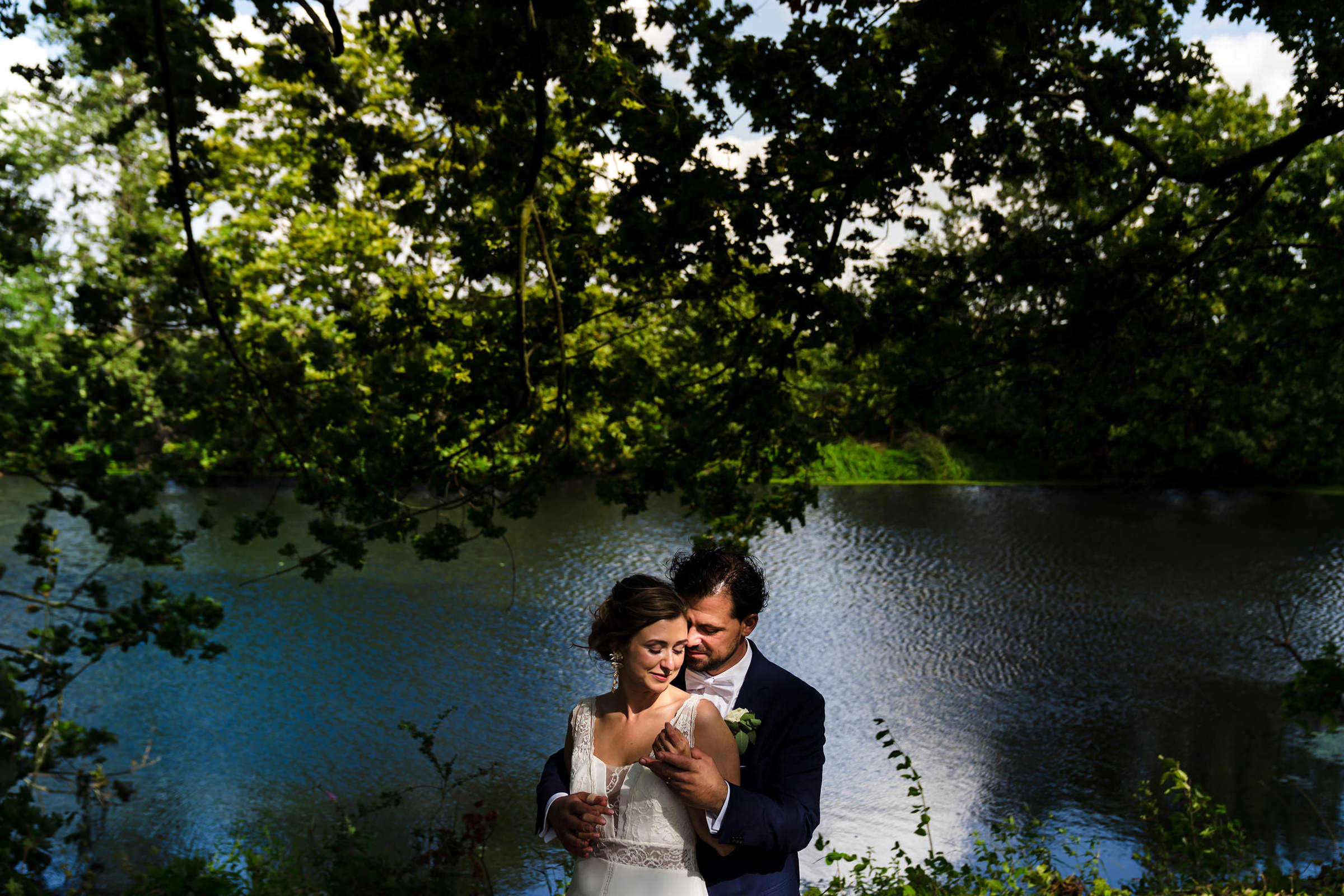 Portrait of bride and groom in a spot of afternoon light, photo by Philippe Swiggers
