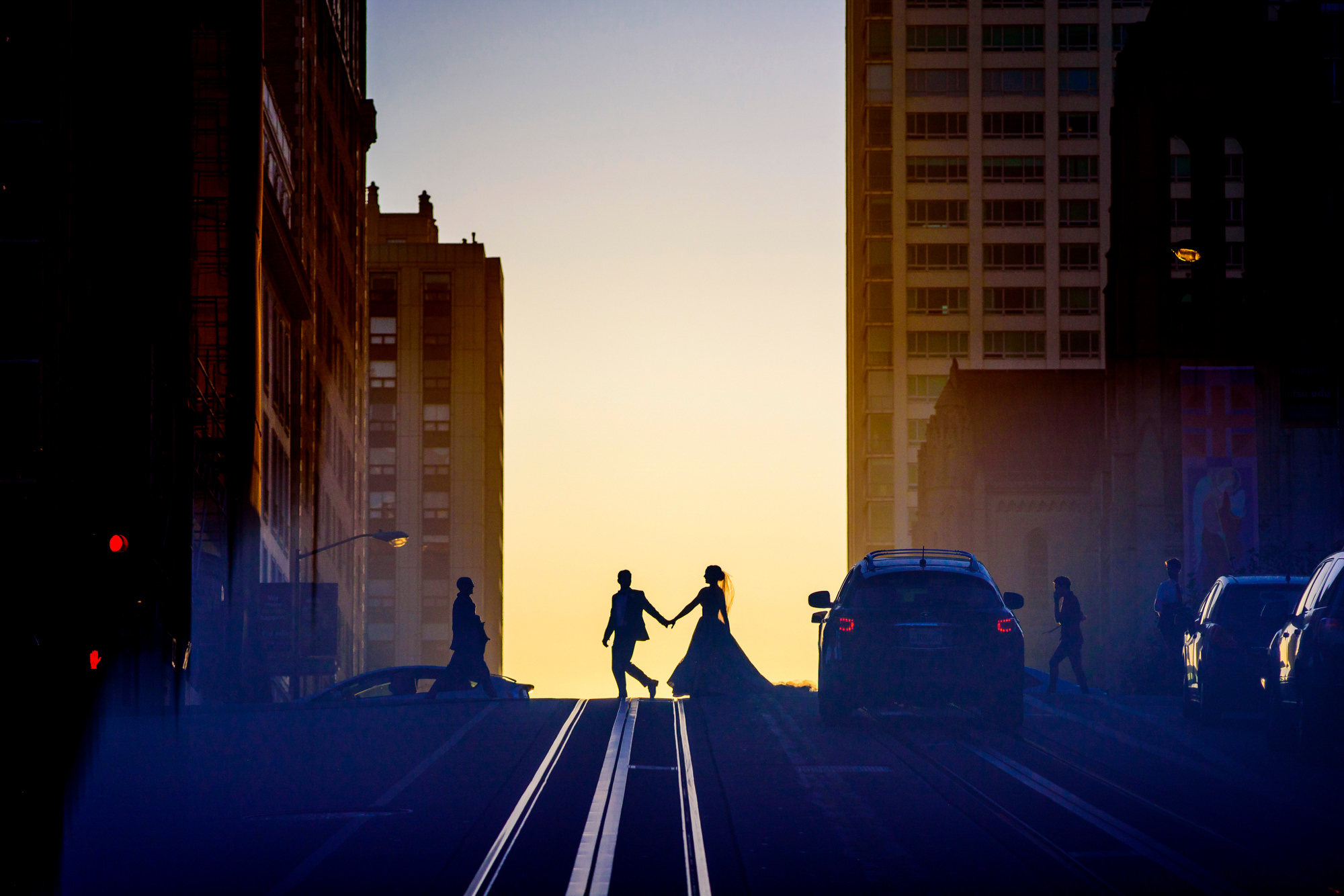 Silhouette of bride and groom crossing street, photo by The Chrismans