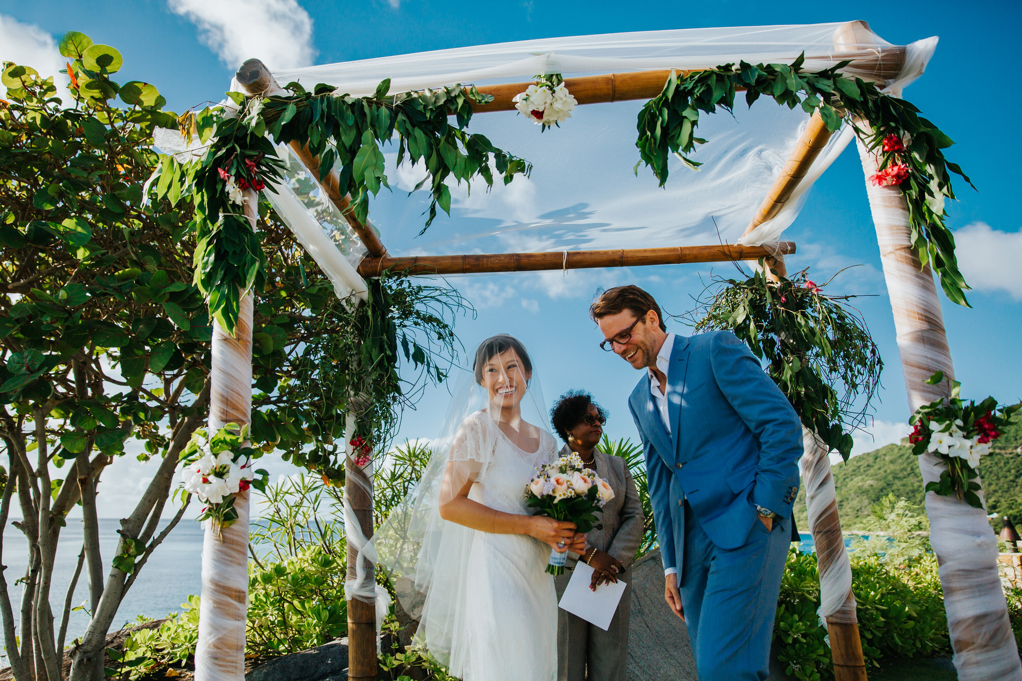 Smiling bride and groom under huppah - photo by Ken Pak