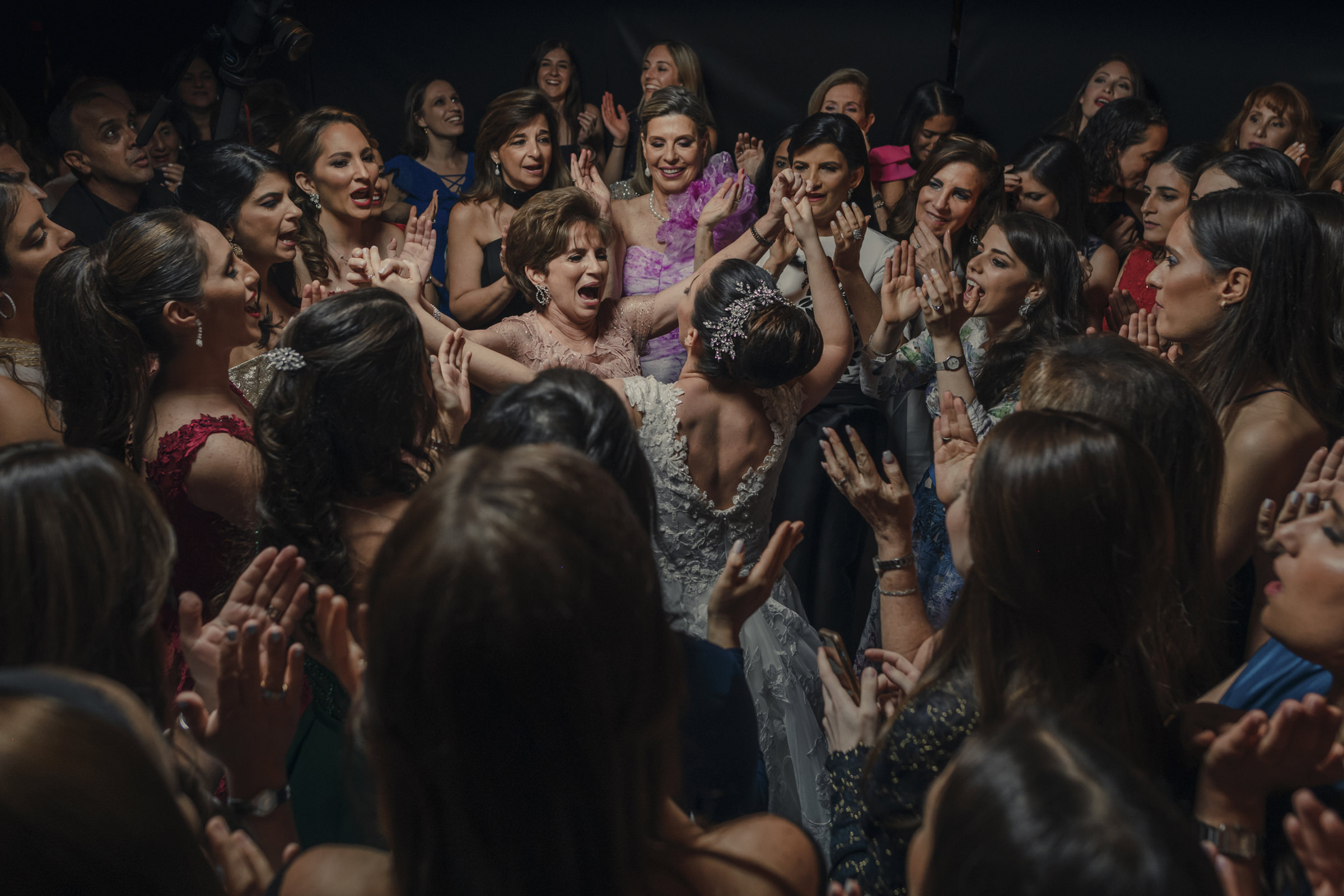 Bride and mother celebrate encircled by friends - photo by El Marco Rojo