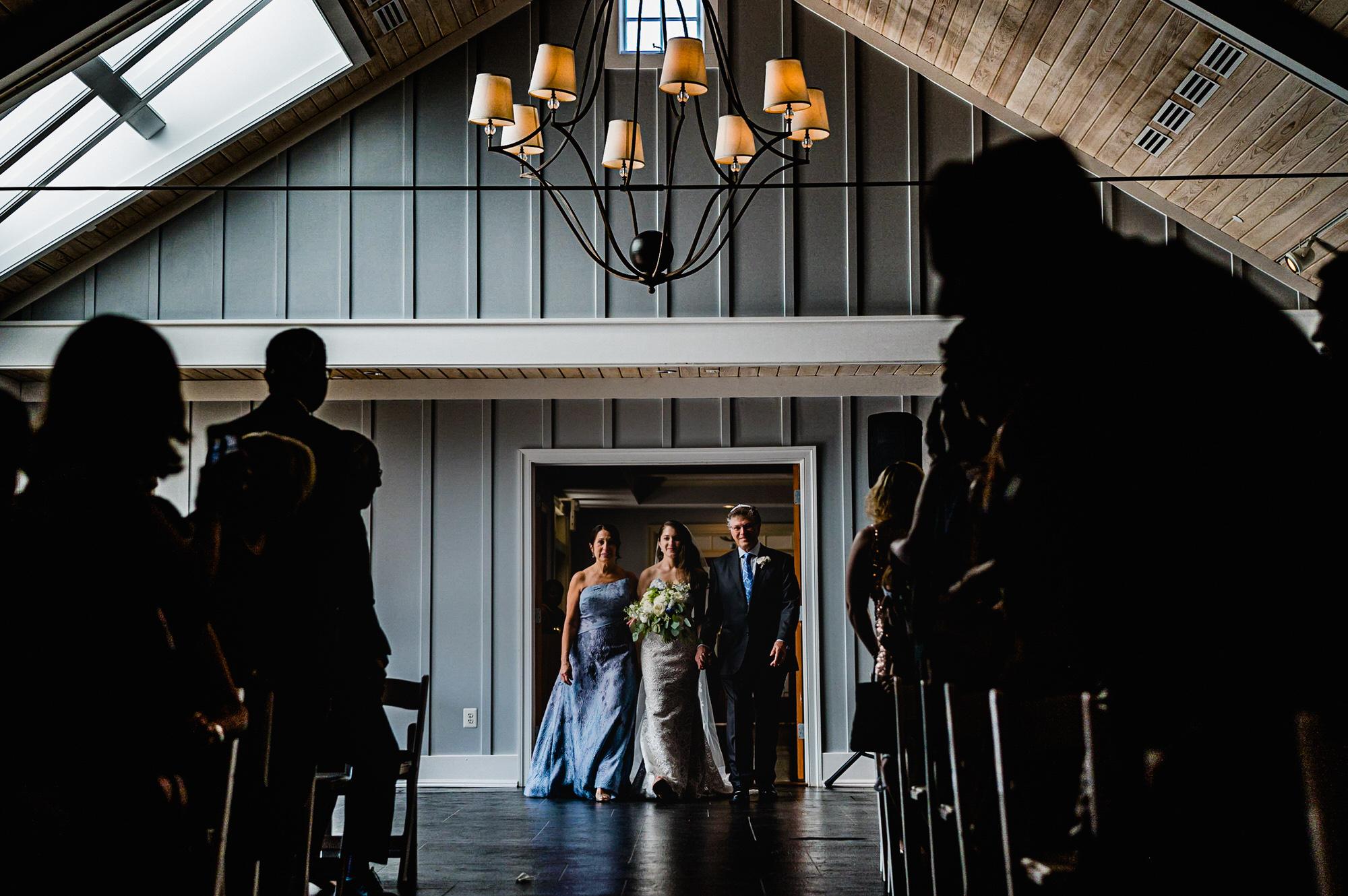 Bride and parents walk down the aisle - photo by Ken Pak