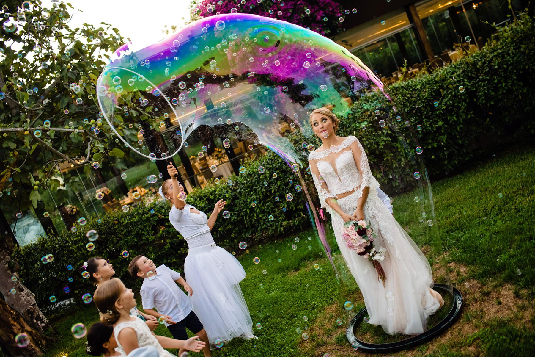 Bride caught in a bubble - Photo by Rich Howman Studios