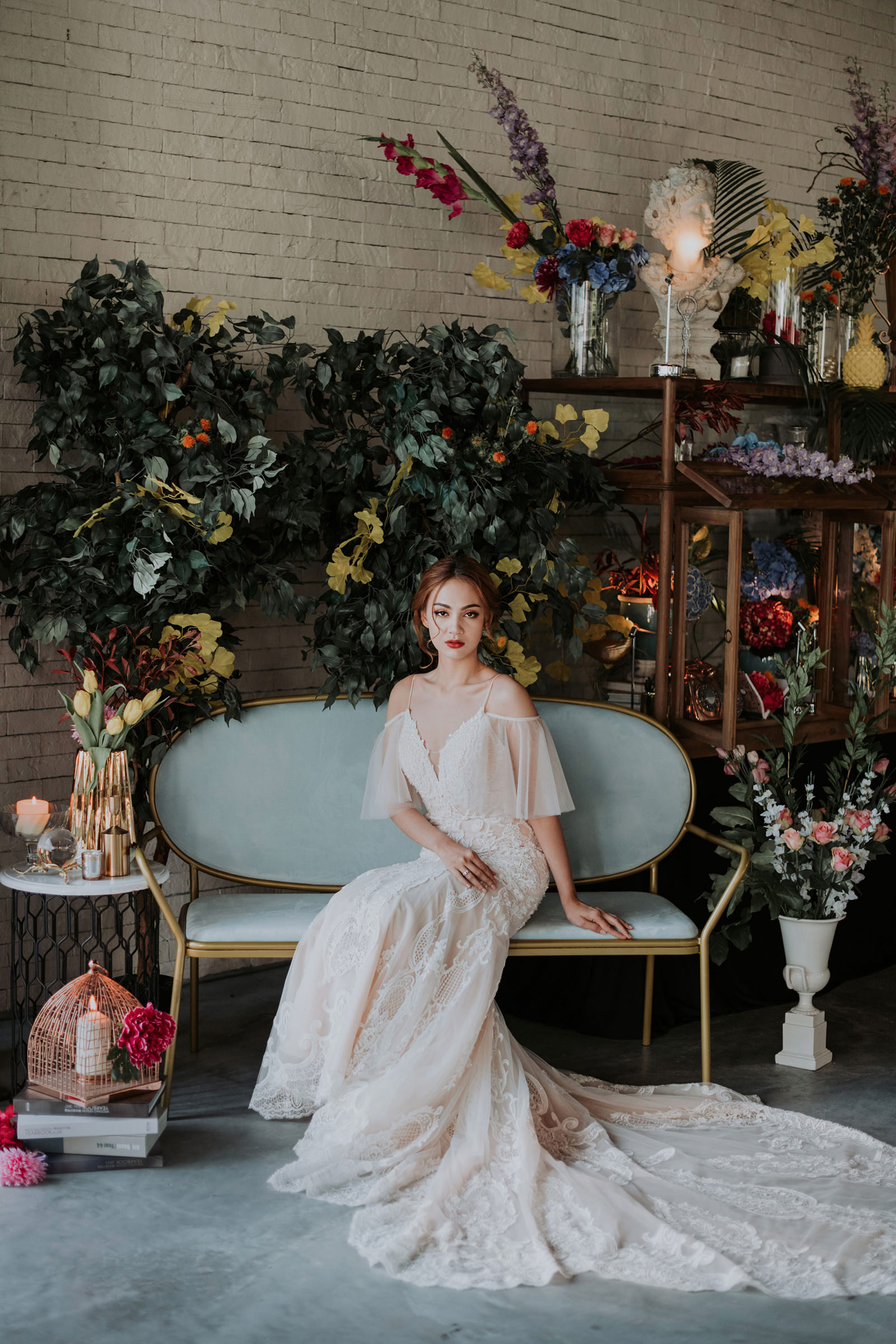 Seated bride in elegant off shoulder gown - Photo by MunKeat Photography Studio