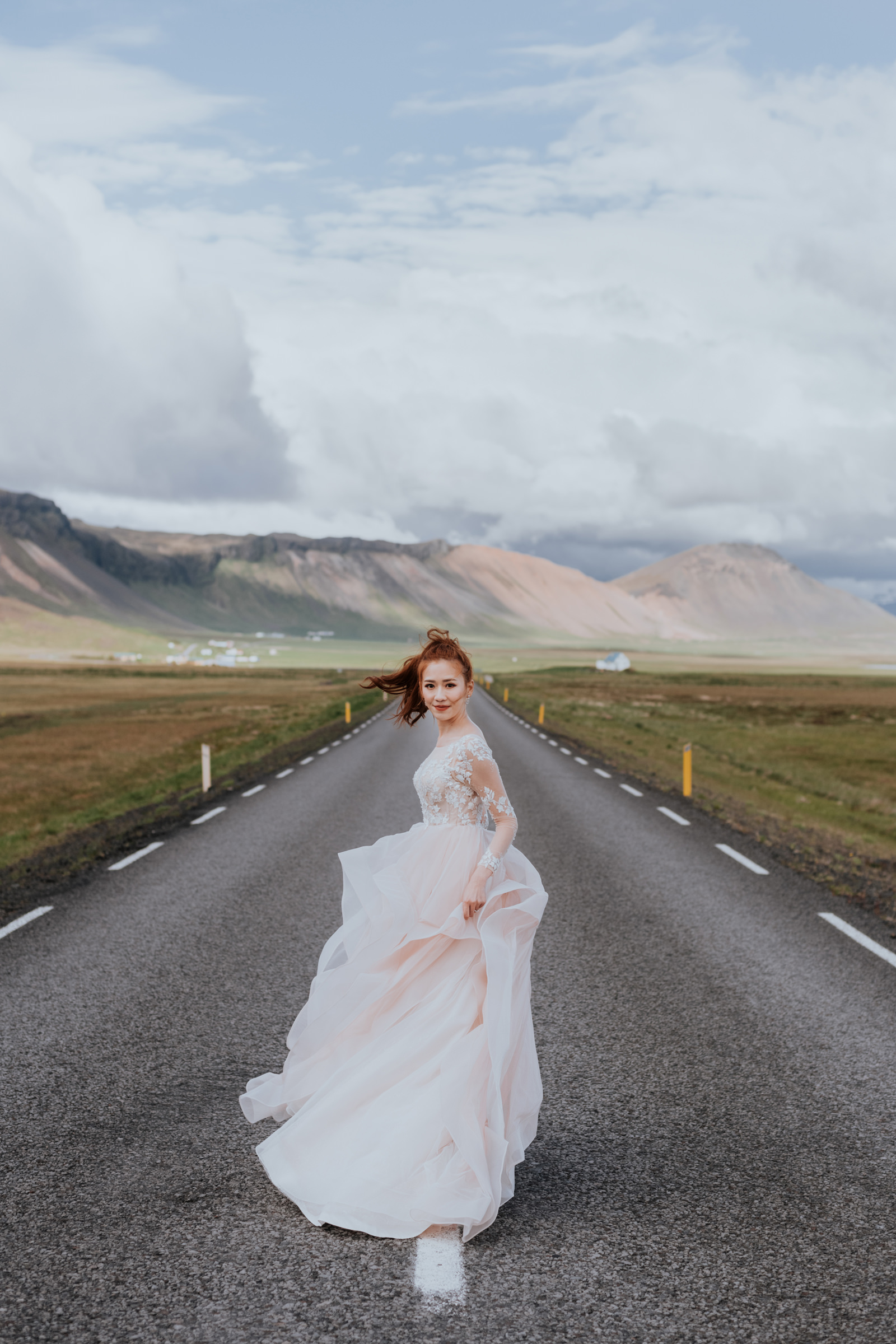 Bride in ruffled gown walking on road - Photo by MunKeat Photography Studio