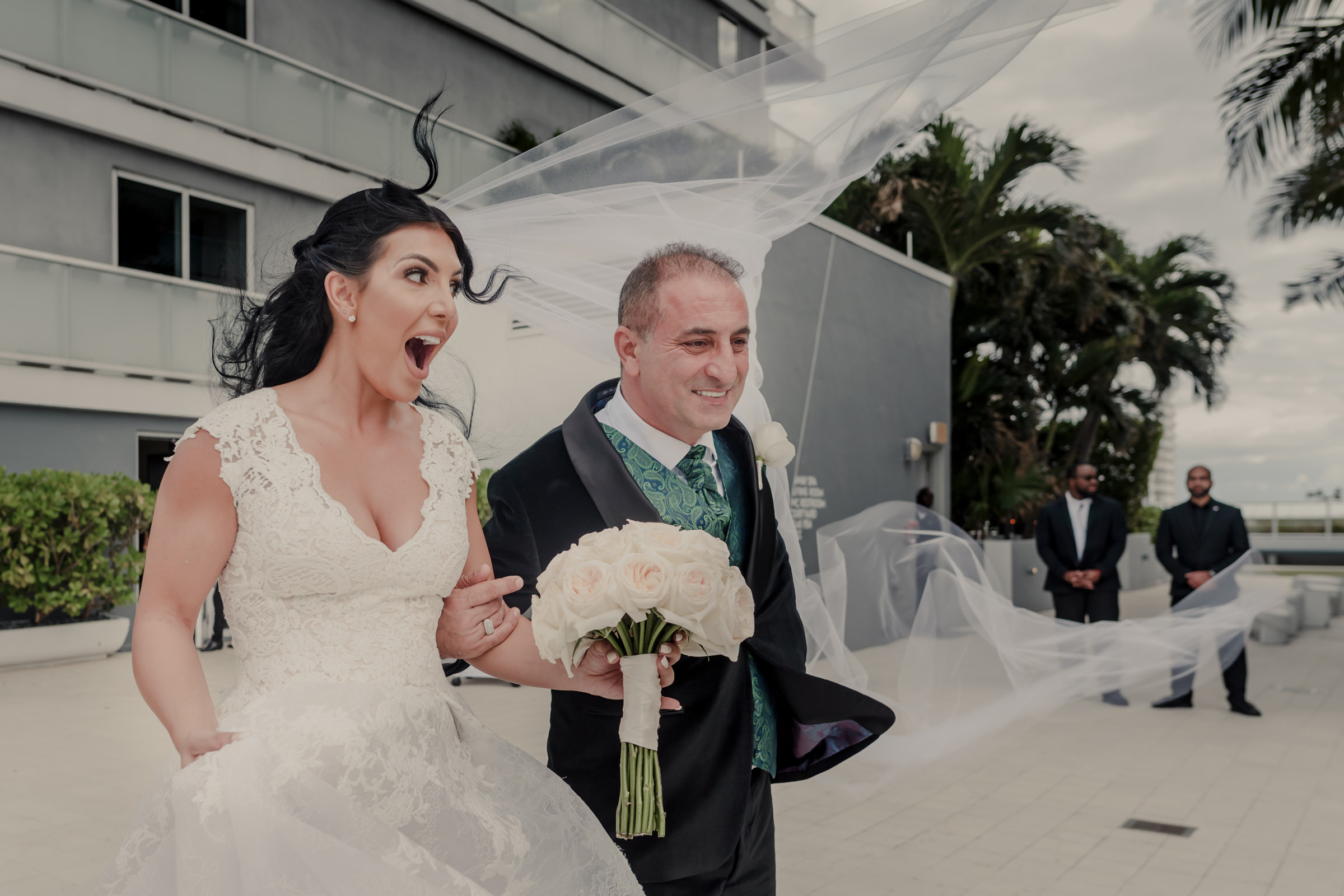 Brides veil blows away walking down the aisle - photo by El Marco Rojo