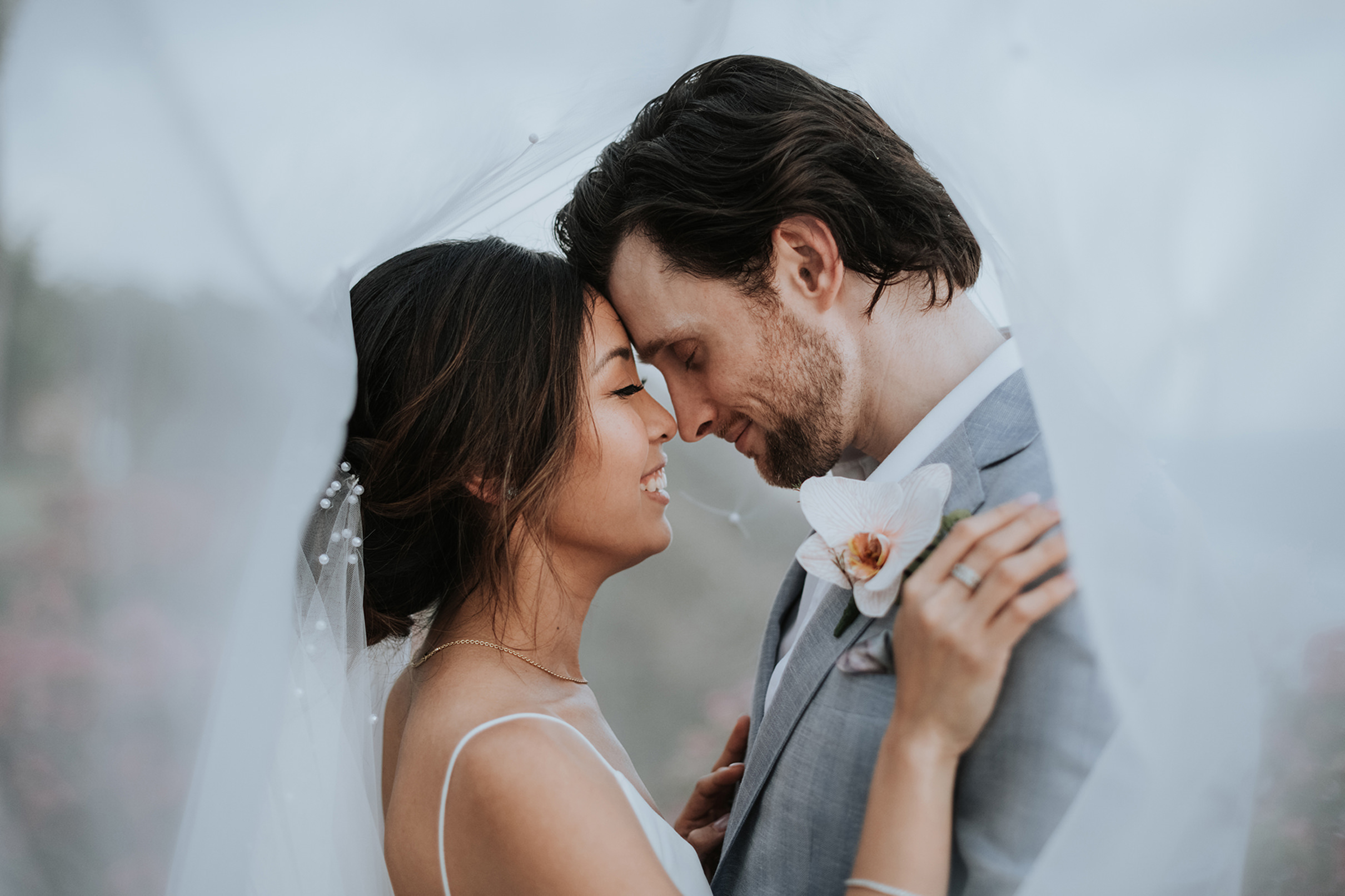 Classic bride and groom under veil. Photo by MunKeat Photography Studio