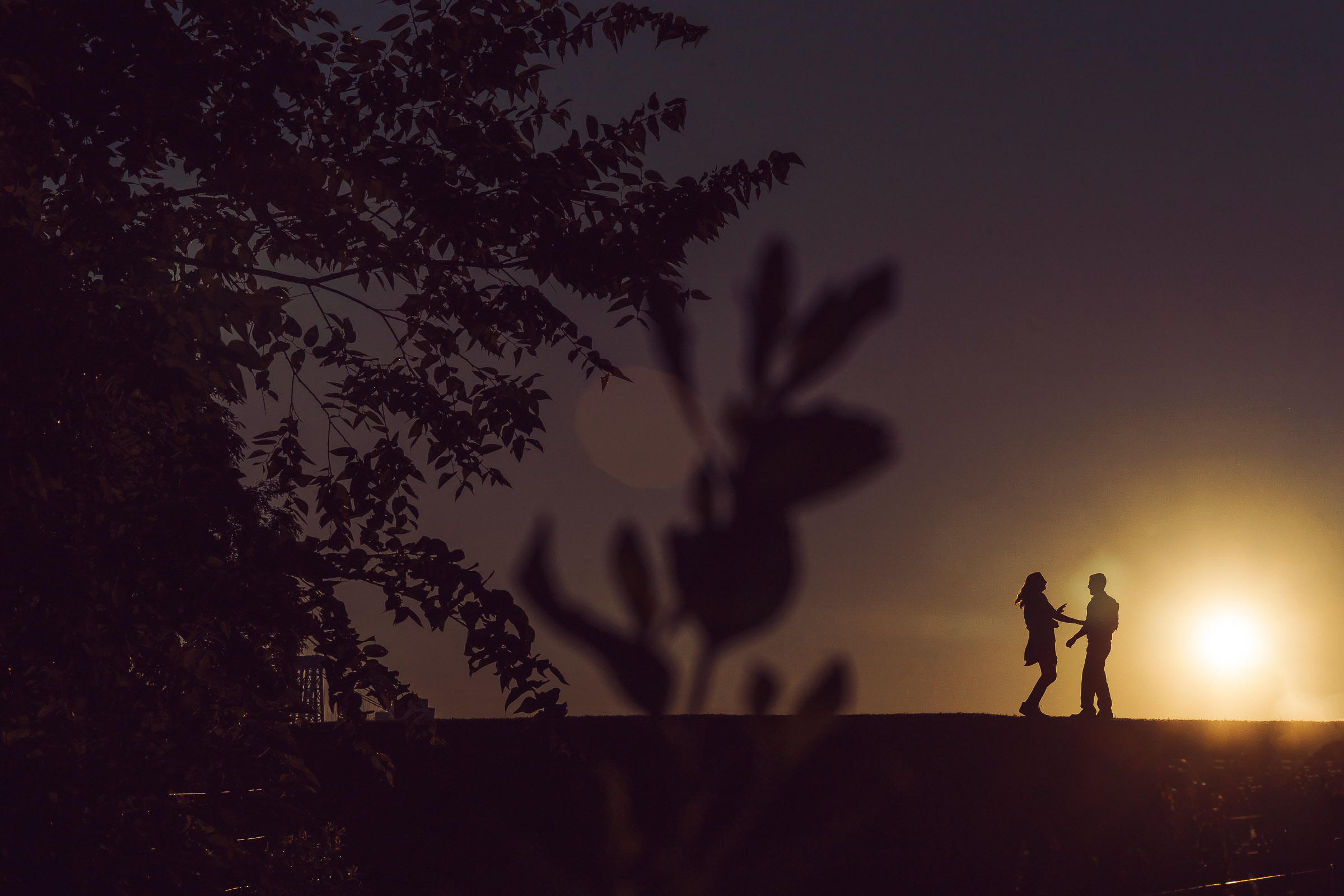 Couple dancing at sunset - photo by The Brenizers