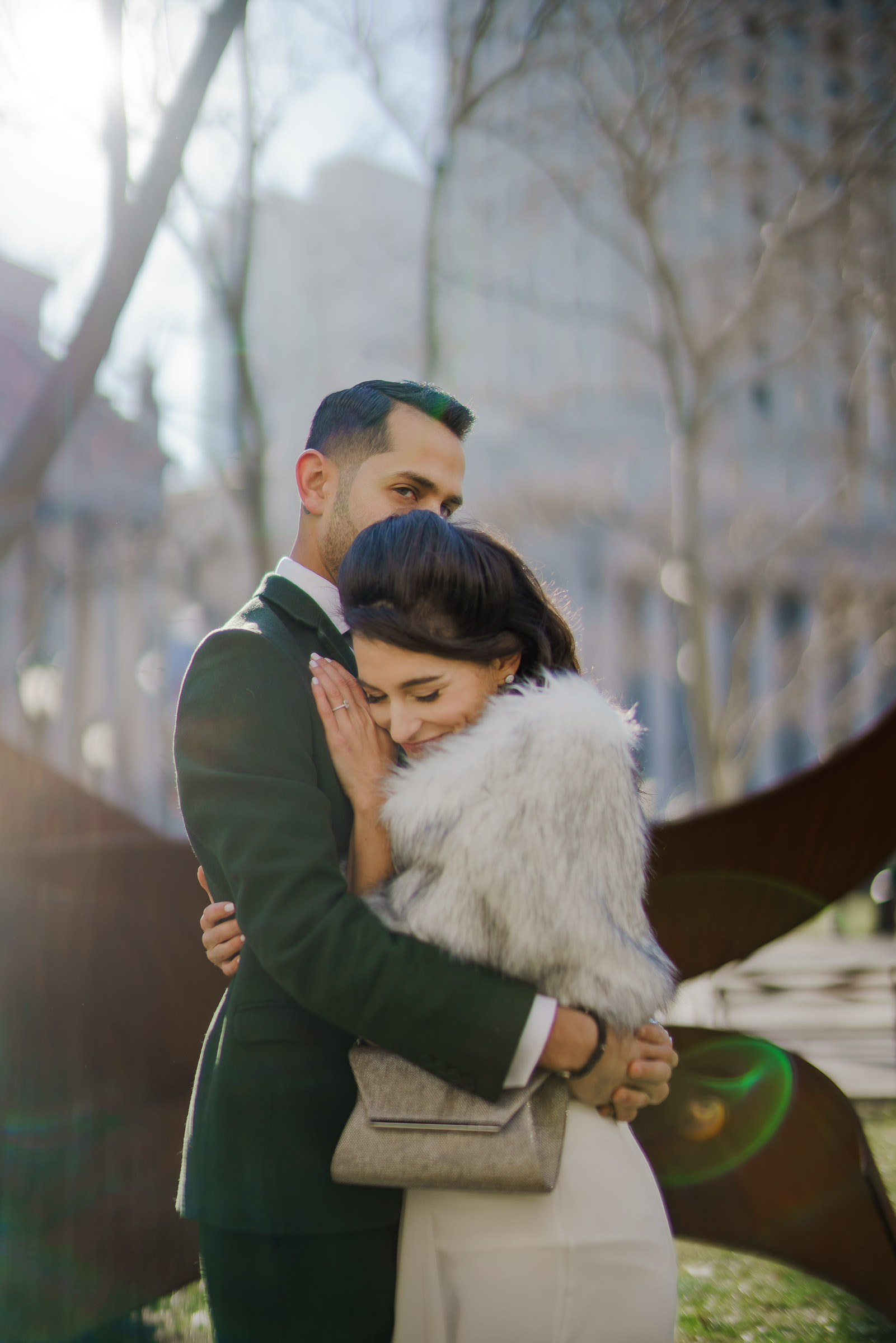 Couple embraces in the park - photo by The Brenizers