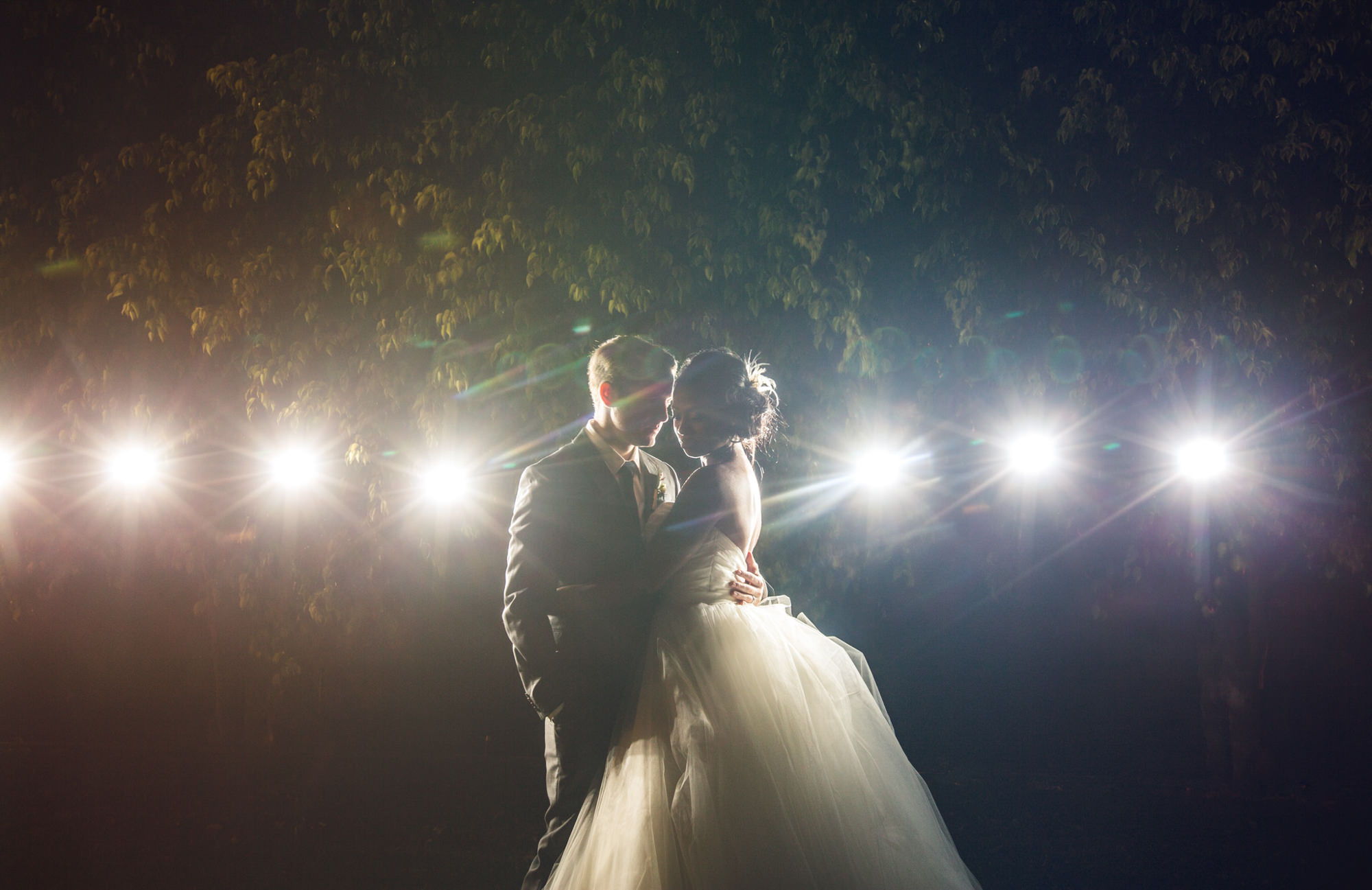 Creative partial silhouette of couple with strobes, by Jeff Newsom