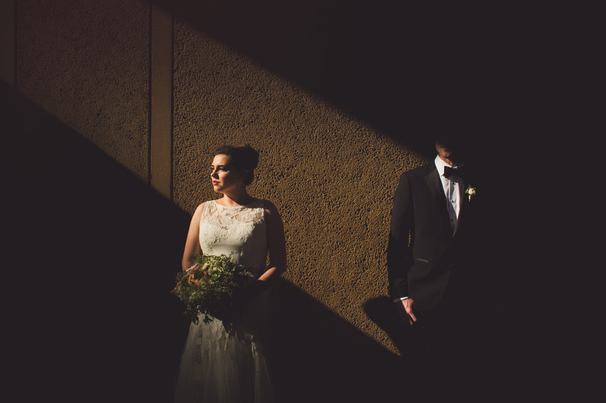 Creative light and shadow portrait of bride and groom, by Jeff Newsom