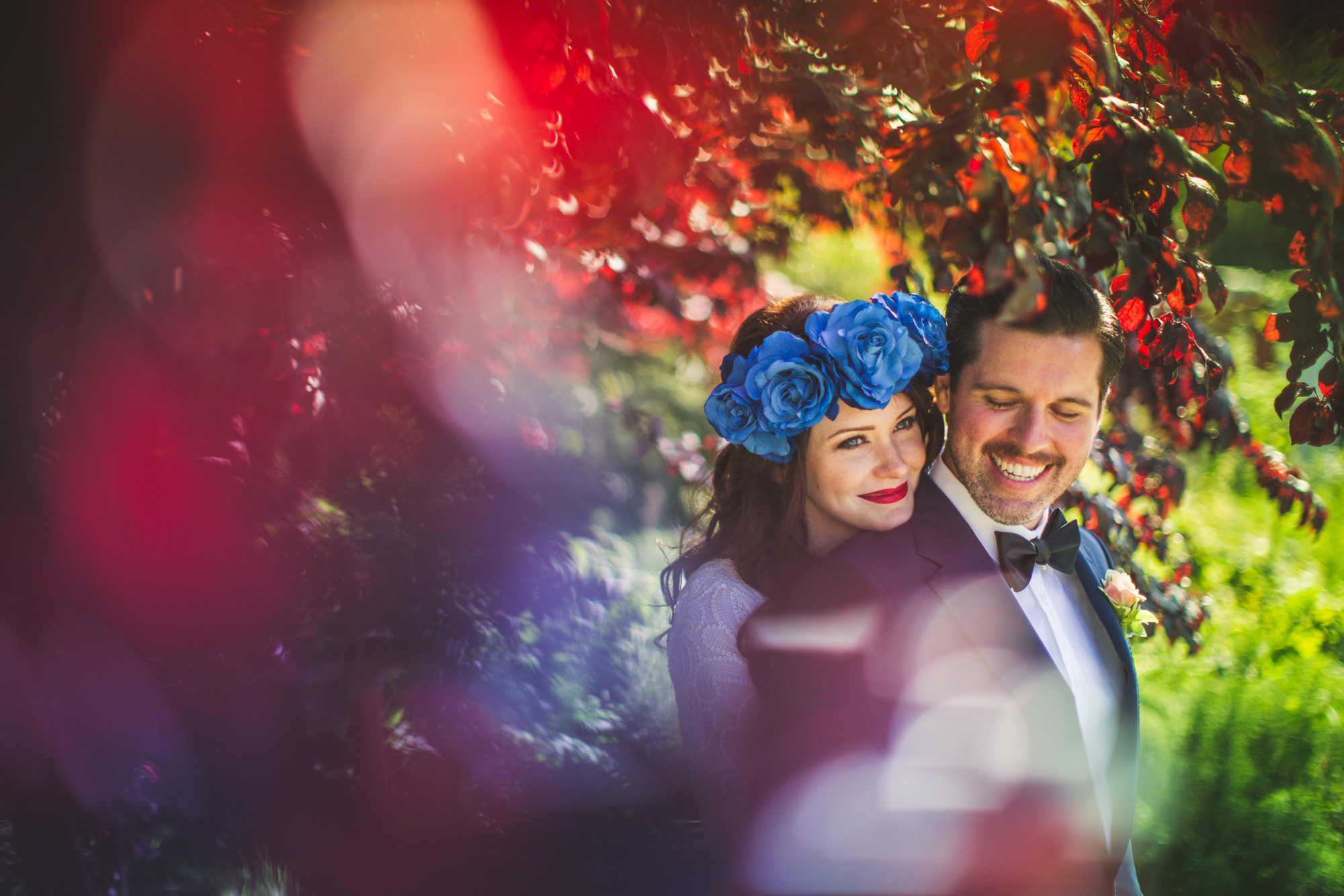 Couple portrait with bride in blue rose crown, by Jeff Newsom