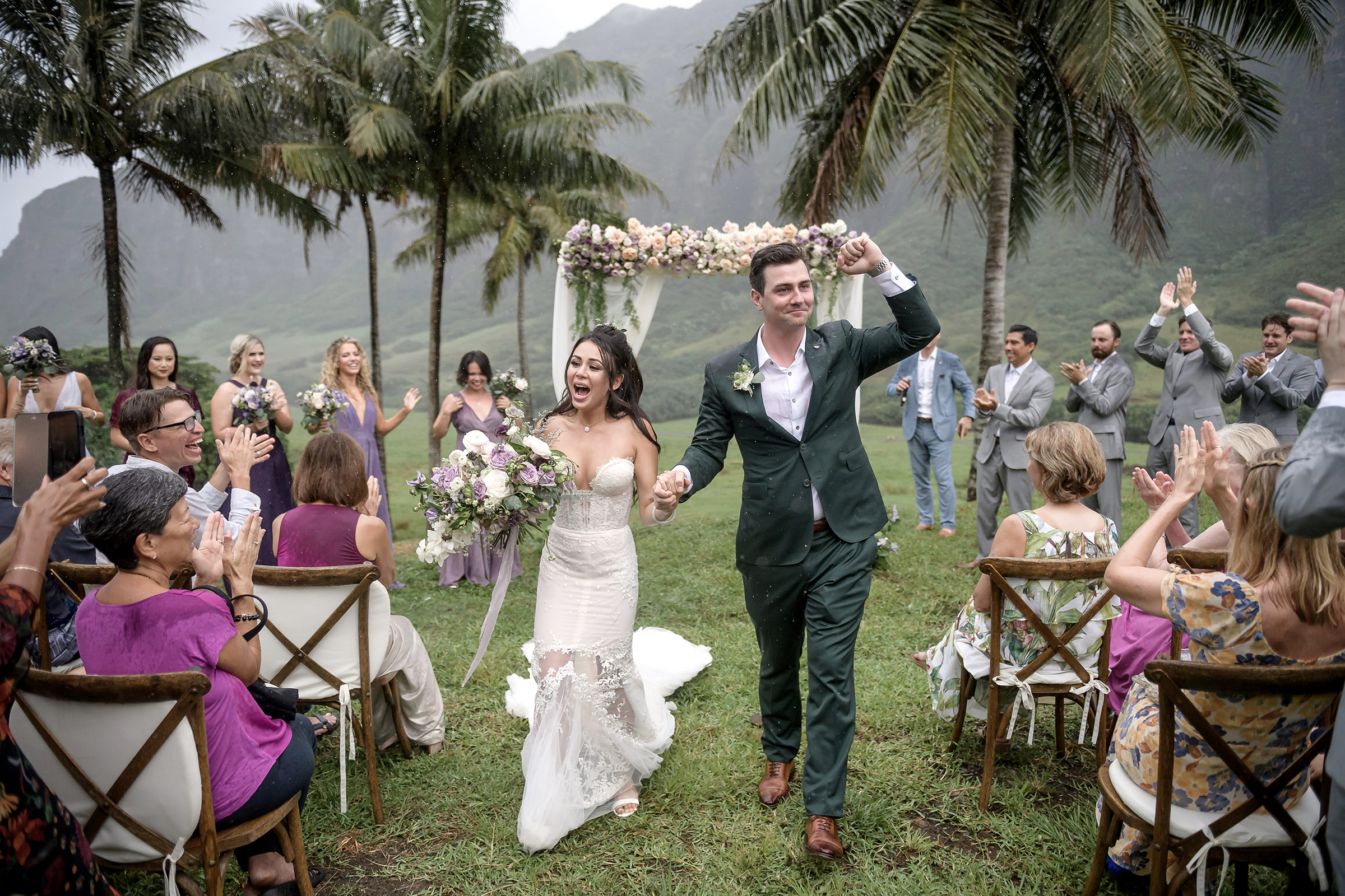 Couple walking down the aisle with palms and mountain - photo by 37 Frames