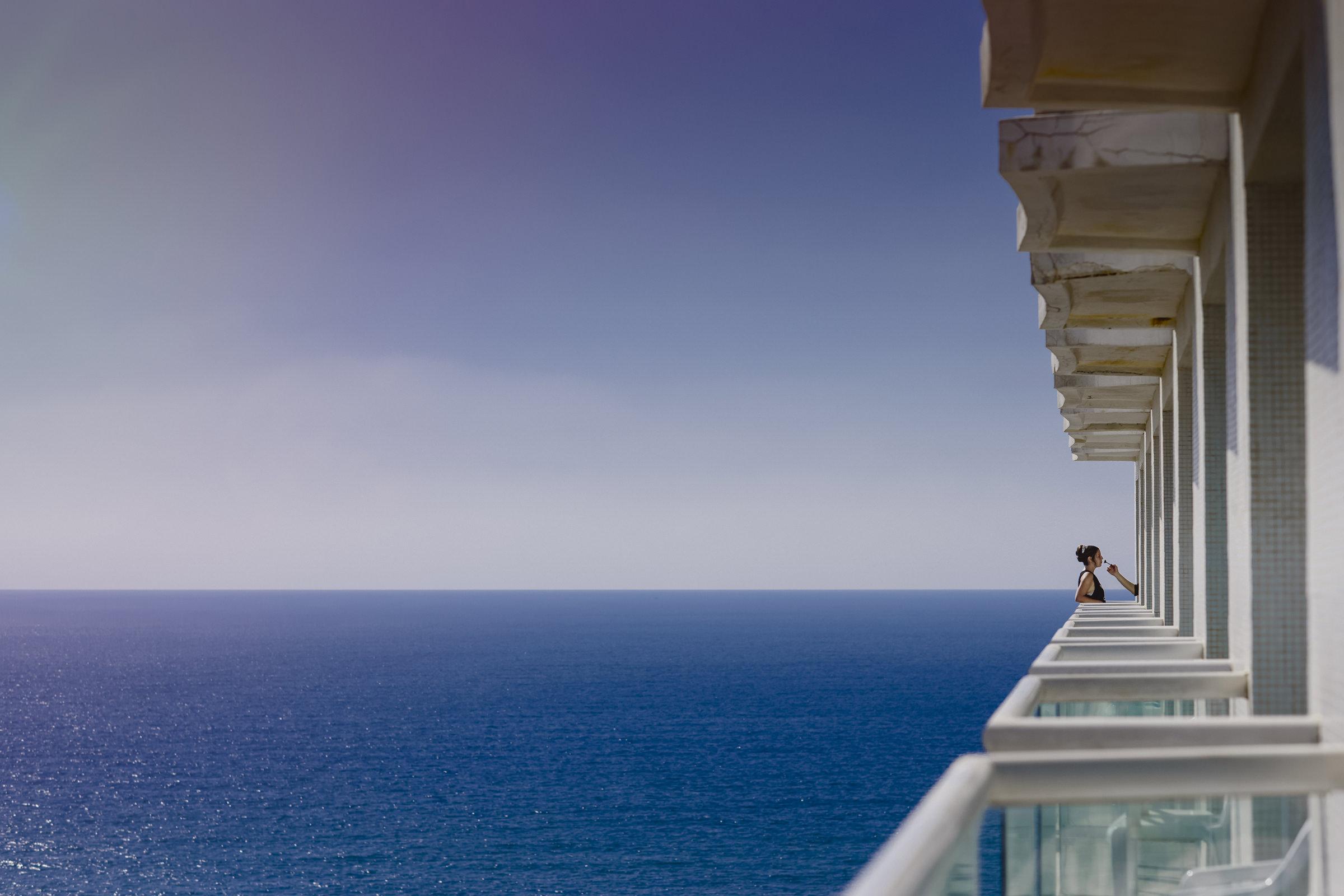 Creative composition bride on waterfront balcony - photo by El Marco Rojo
