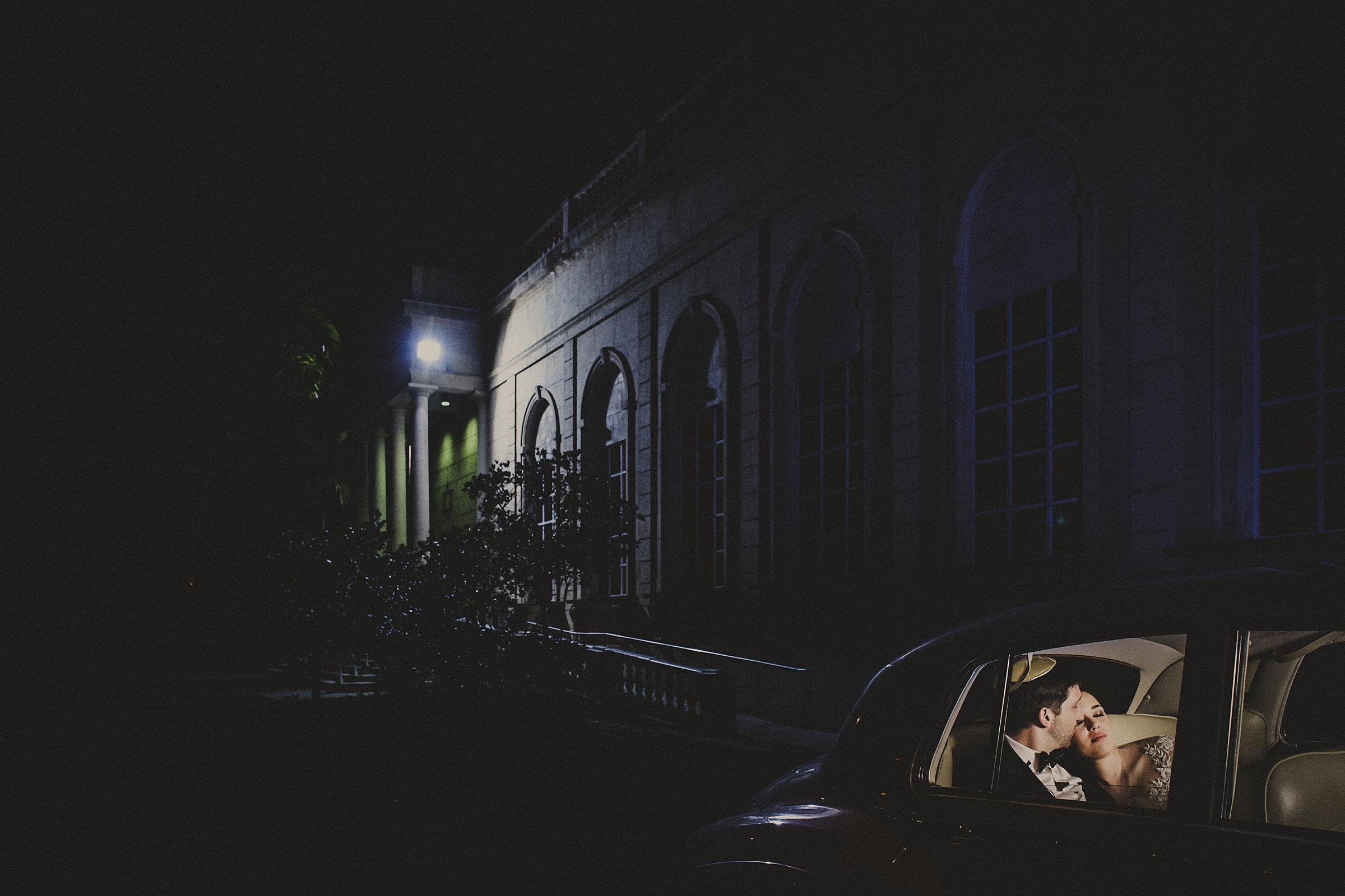 Creative composition lighting couple in antique car - photo by El Marco Rojo