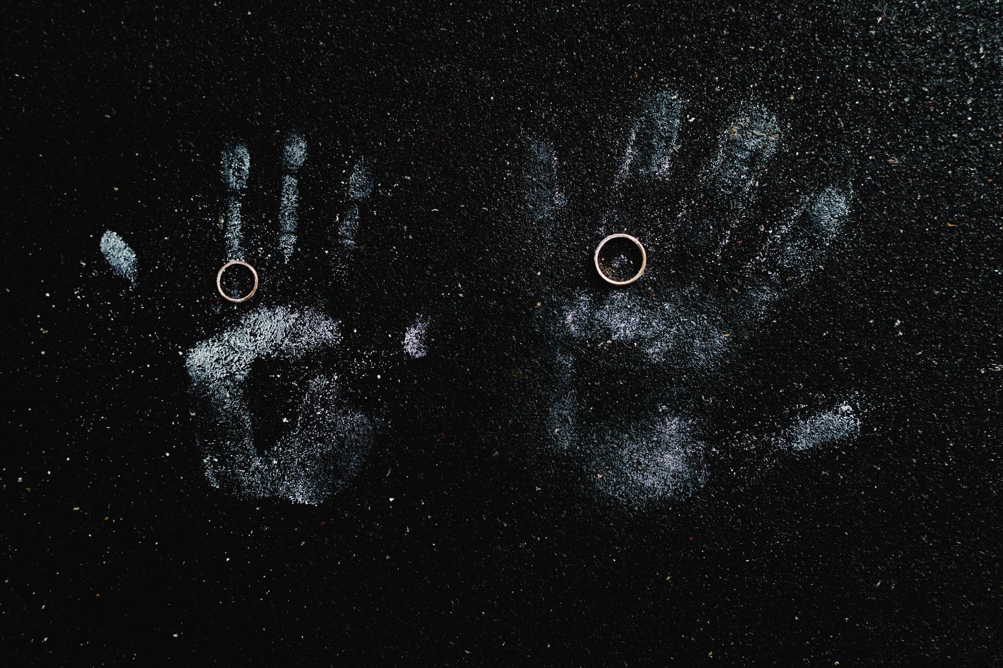 Rings against handprints - photo by Ken Pak