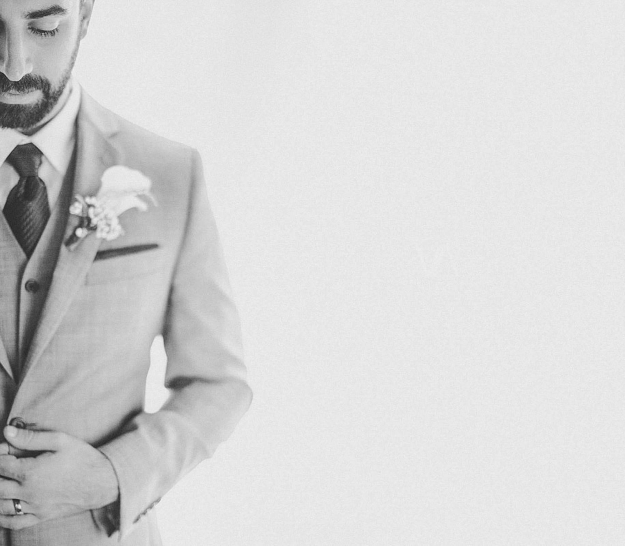 Creative black and white half portrait of groom, by Jeff Newsom