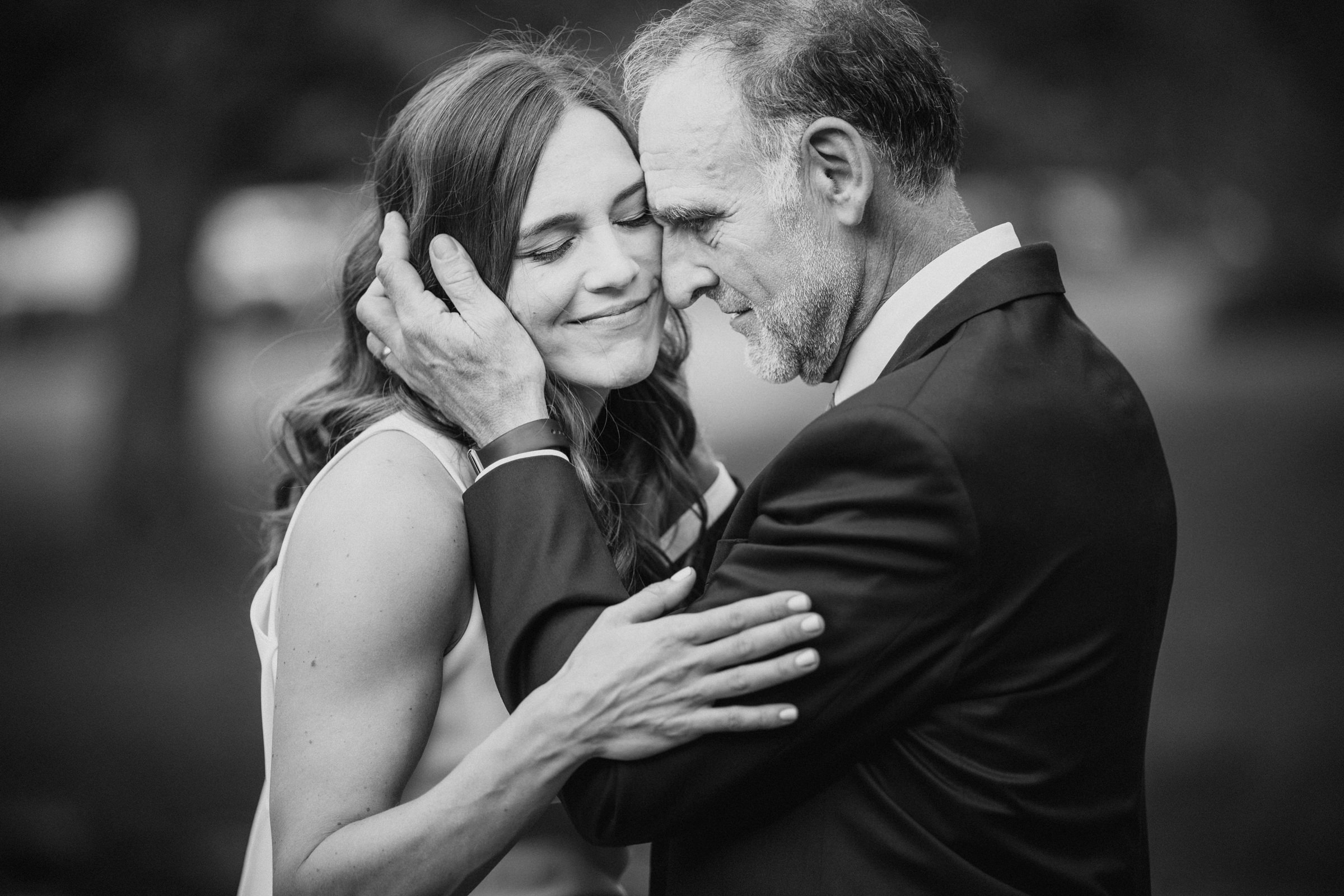 Dad embraces bride - Photo by Susan Stripling Photography