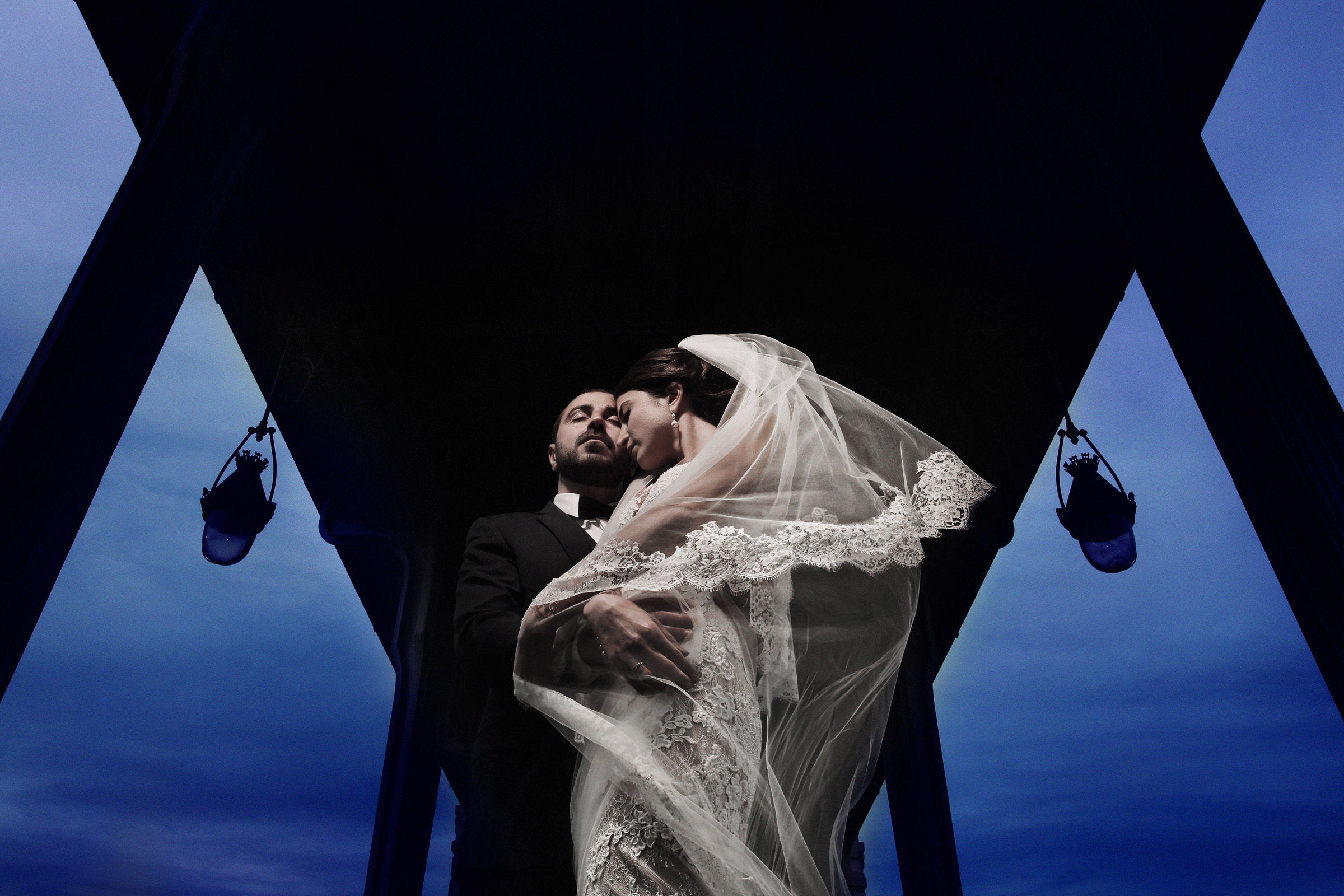 Dramatic portrait of bride and groom, by Franck Boutonnet