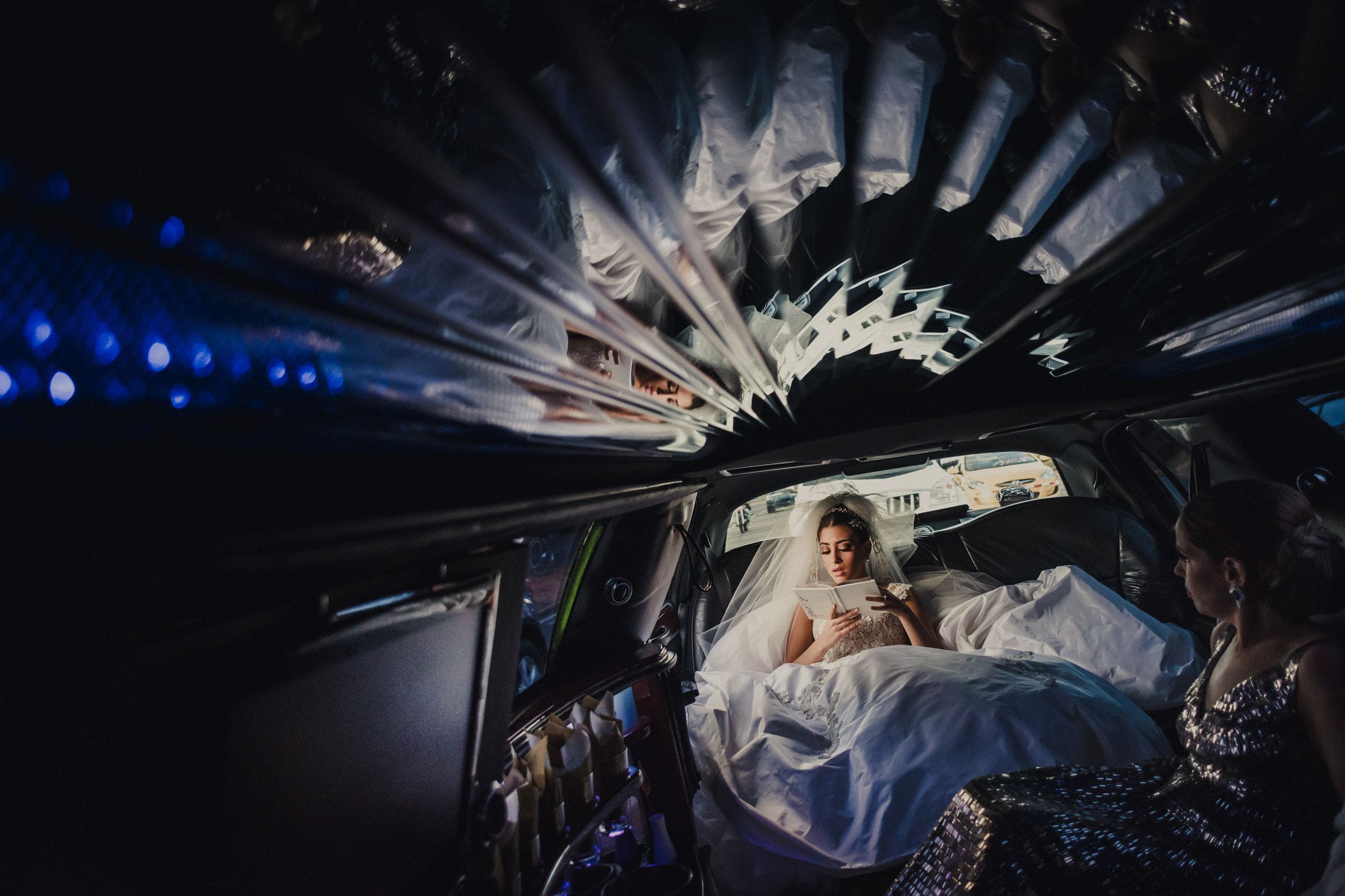 Bride reflected in limousine ceiling - photo by El Marco Rojo