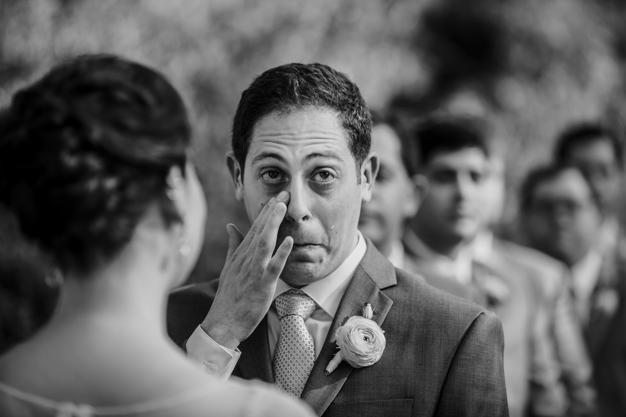 Emotional groom at ceremony - photo by Ken Pak