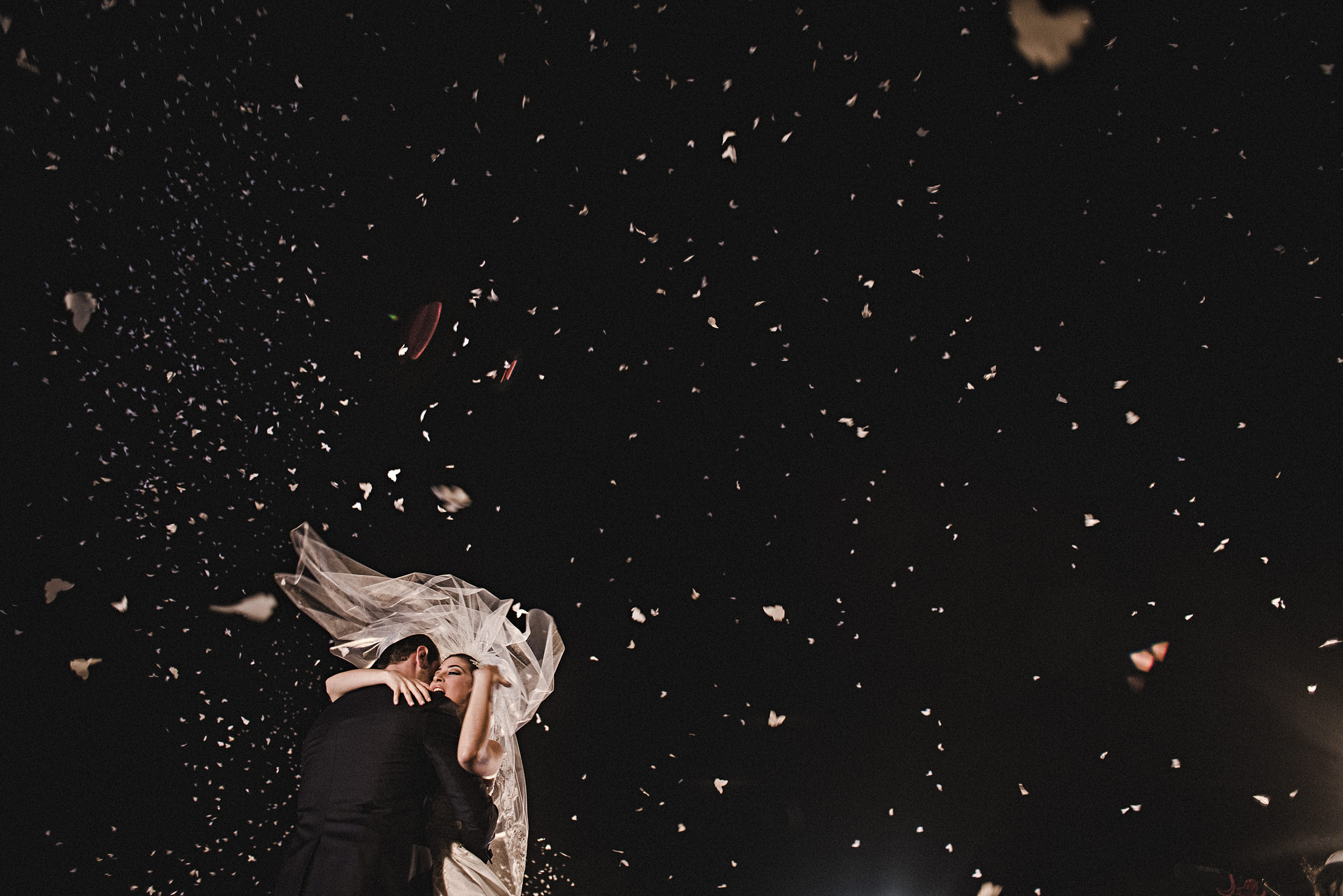 Festive moment with couple surrounded by butterflies - photo by El Marco Rojo