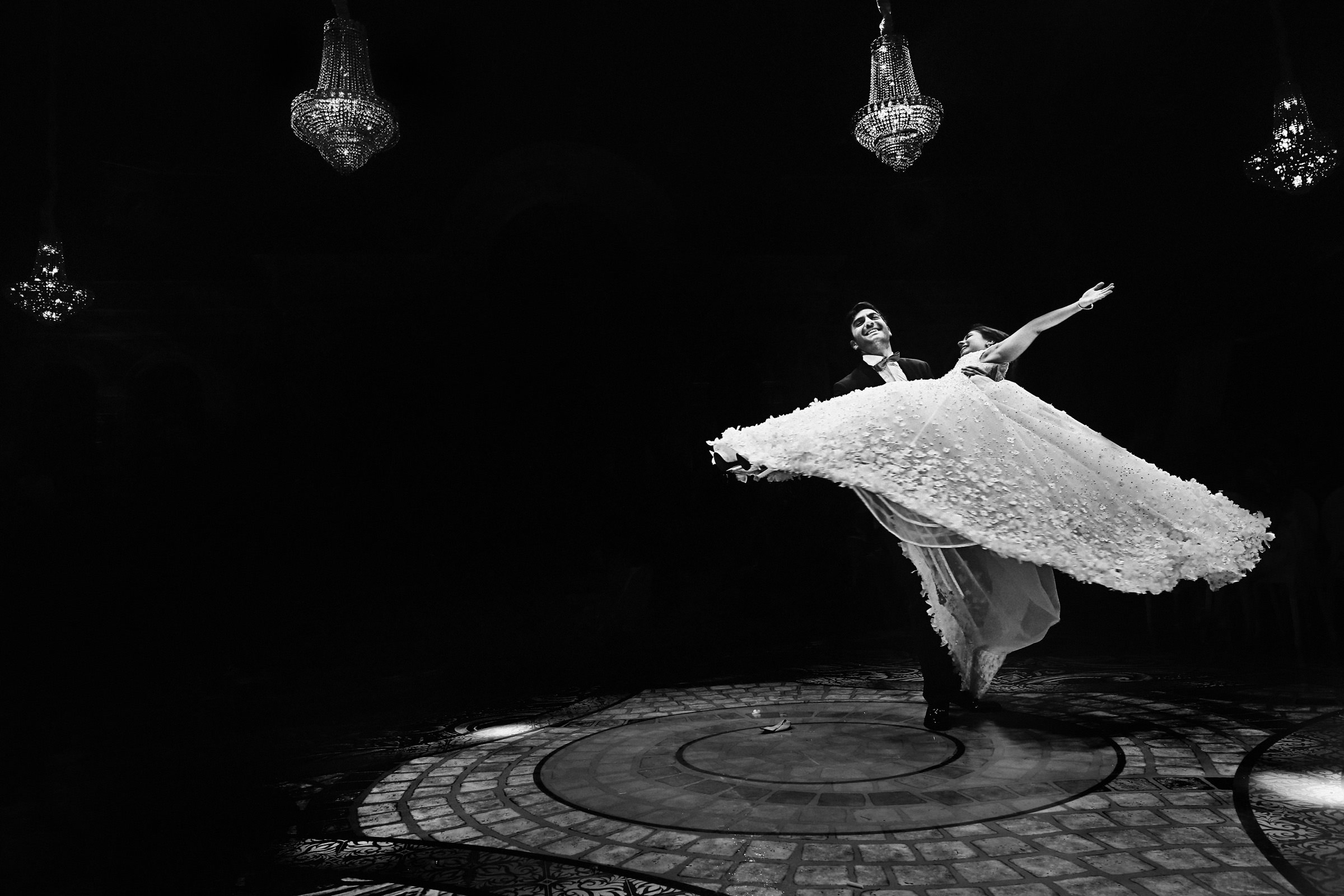 First dance of couple twirling on dance floor, by Franck Boutonnet