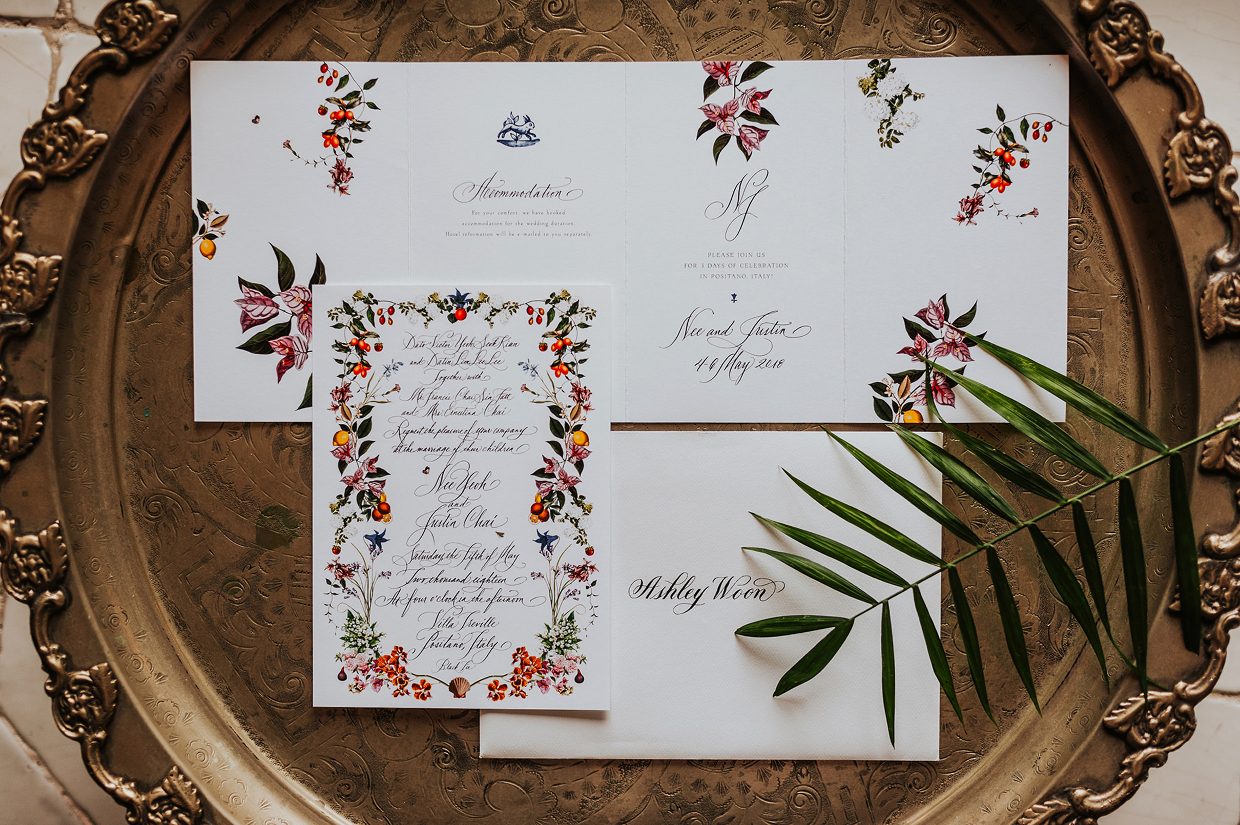 Flatlay of colorful wedding invitations - Photo by MunKeat Photography Studio