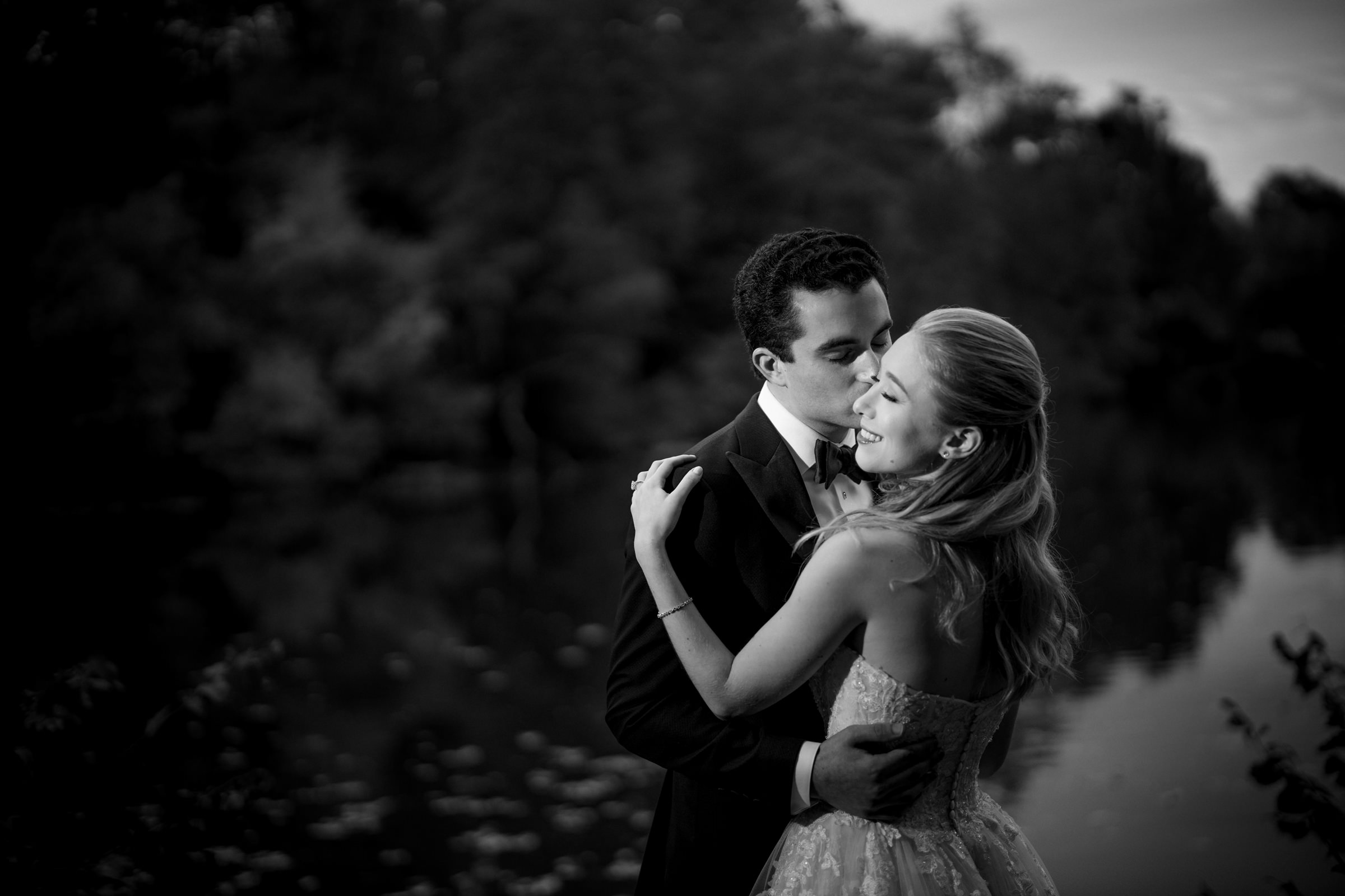Romantic groom kisses bride on cheek - Photo by Susan Stripling Photography
