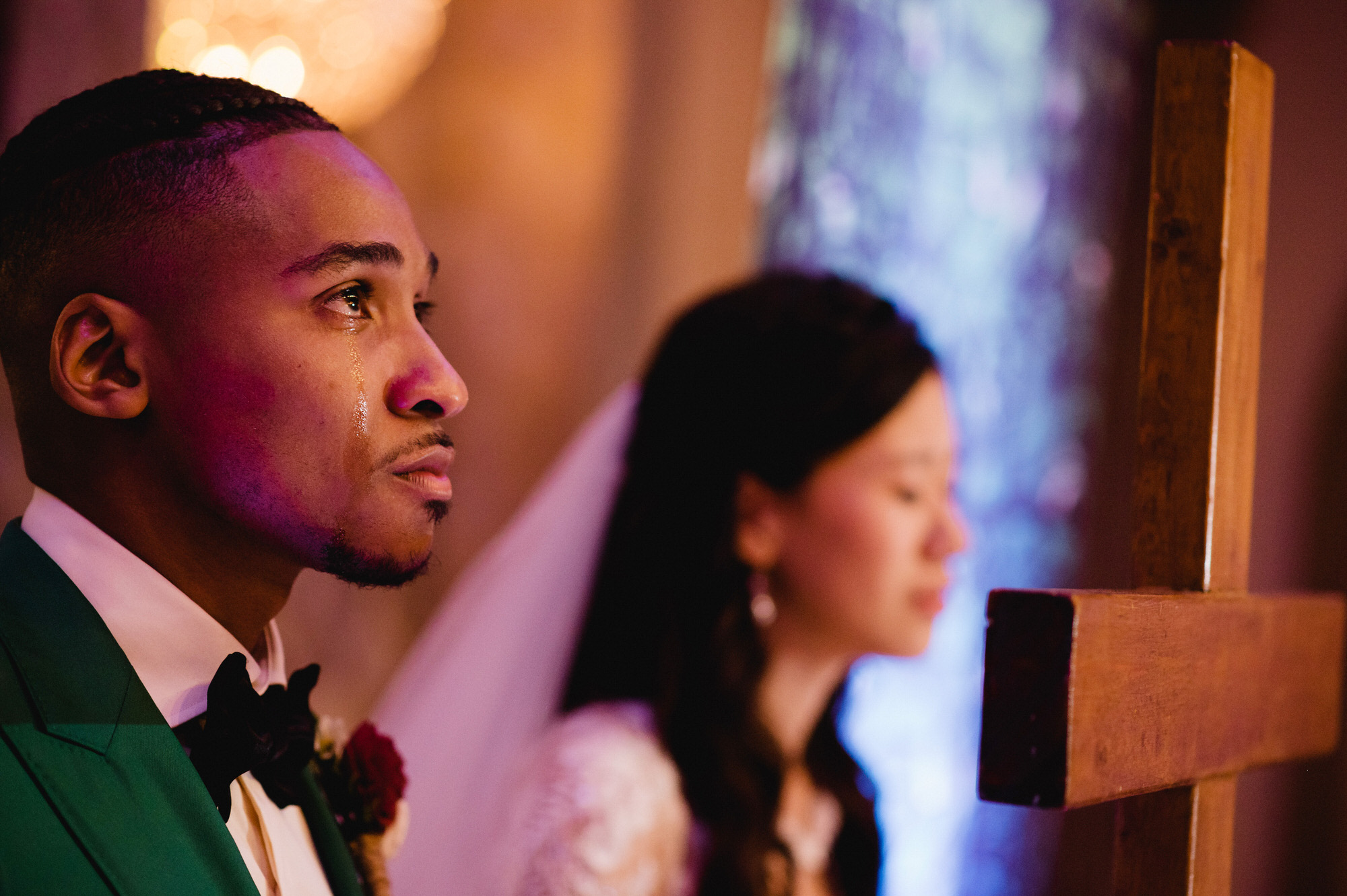 Groom tears up at ceremony - photo by Ken Pak