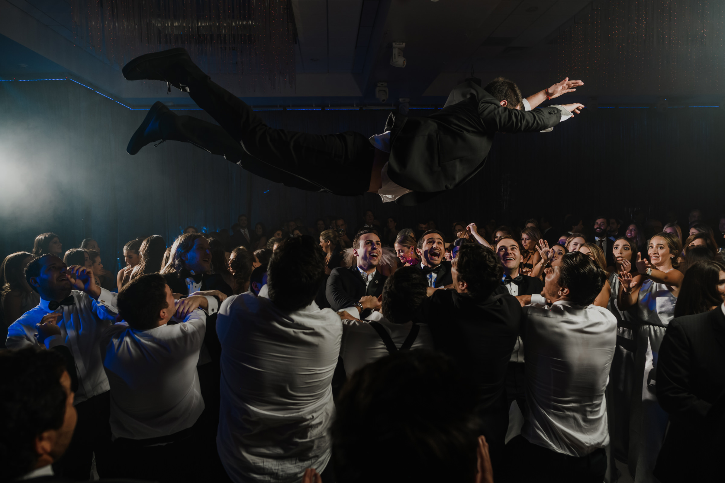 Groom flies into mosh pit at reception - photo by El Marco Rojo
