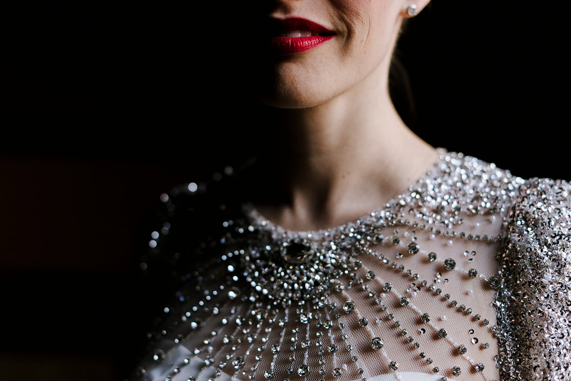 Jeweled gown detail shot of bride by Thierry Joubert