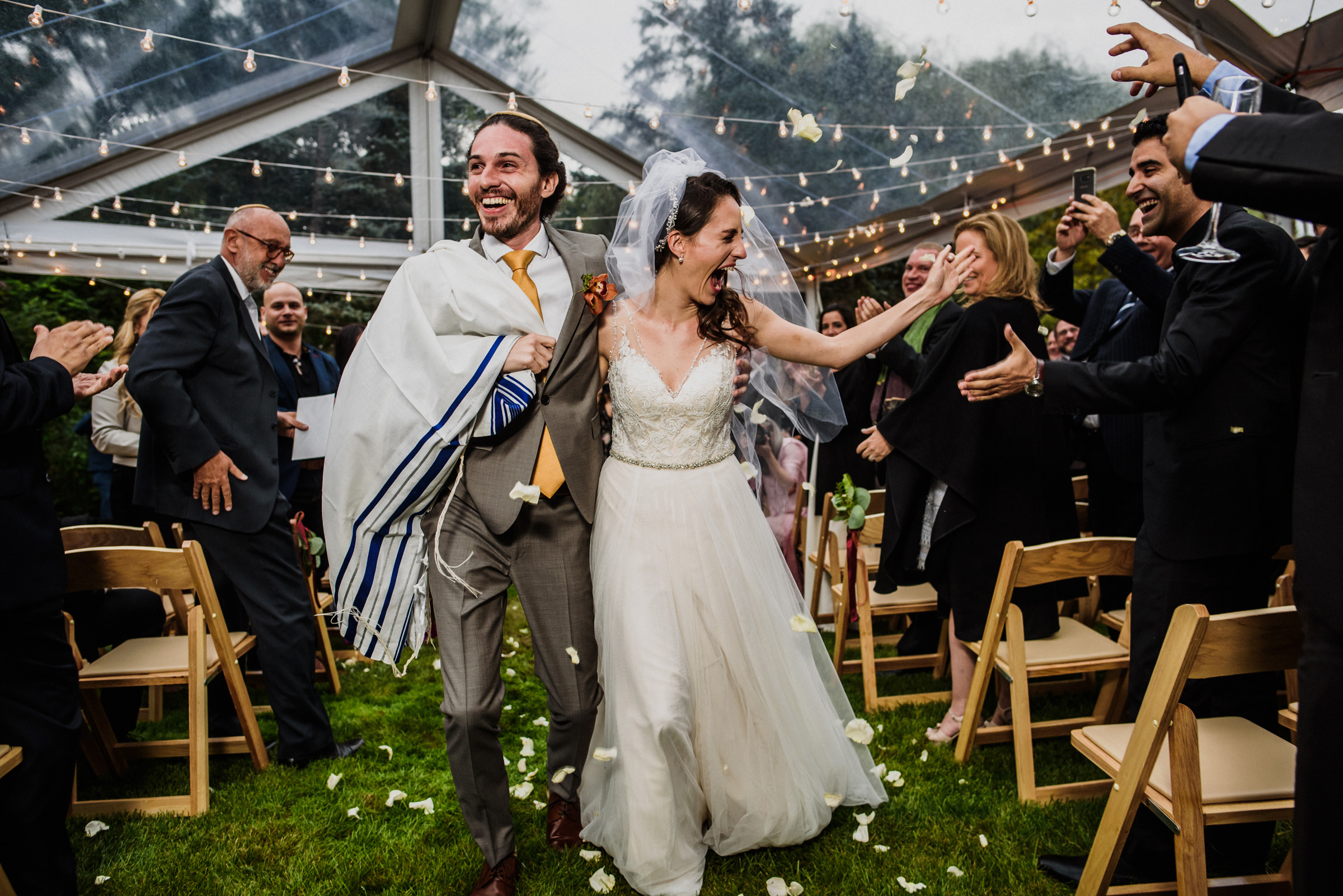 Just married couple slaps hands with guest - photo by El Marco Rojo