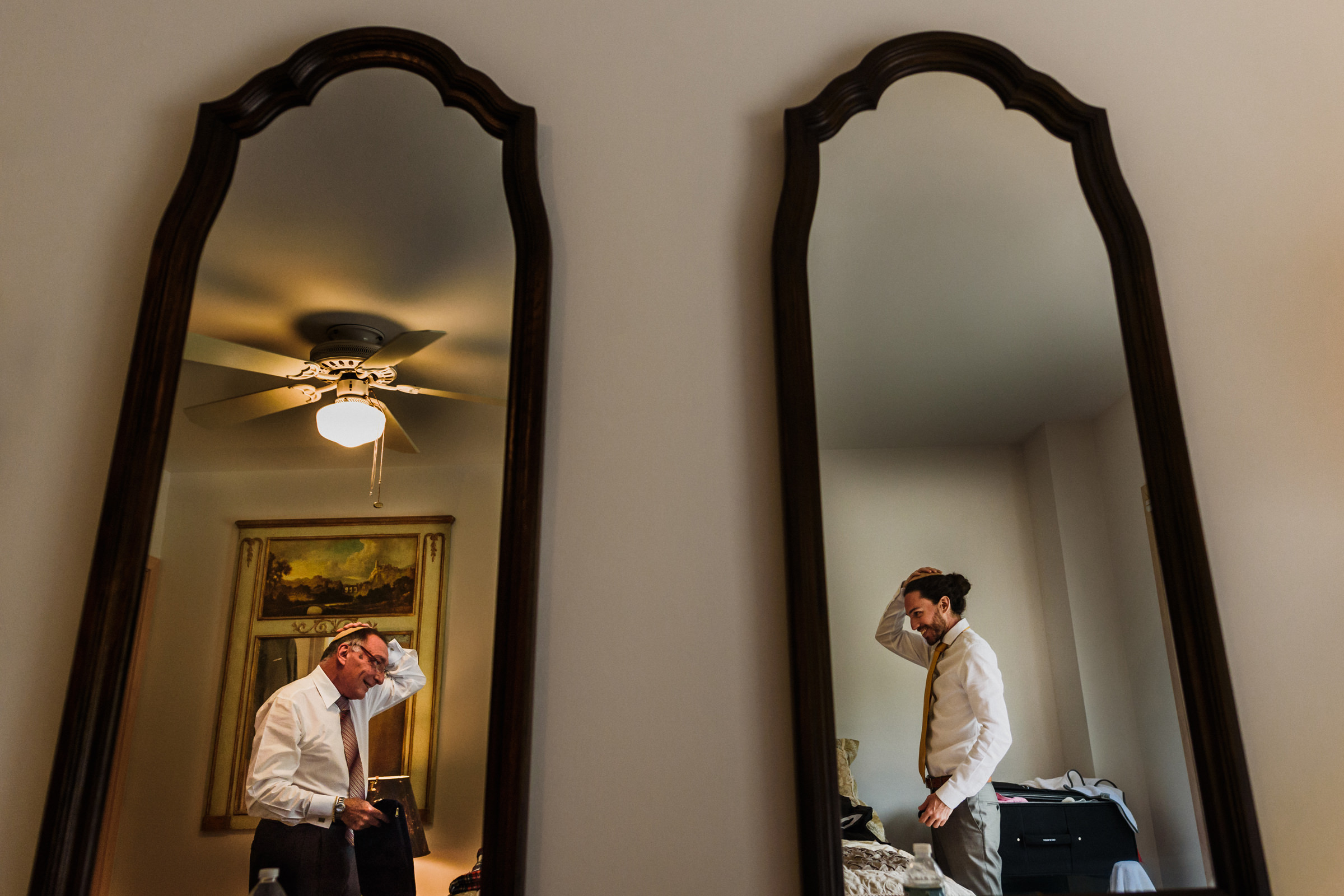 Groom and father reflected in mirror put on yarmulkes - photo by El Marco Rojo