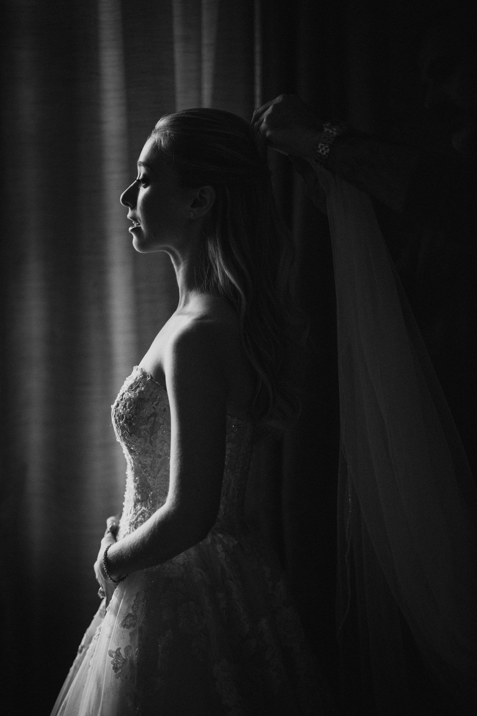 Moody black and white bridal portrait by window, by Susan Stripling