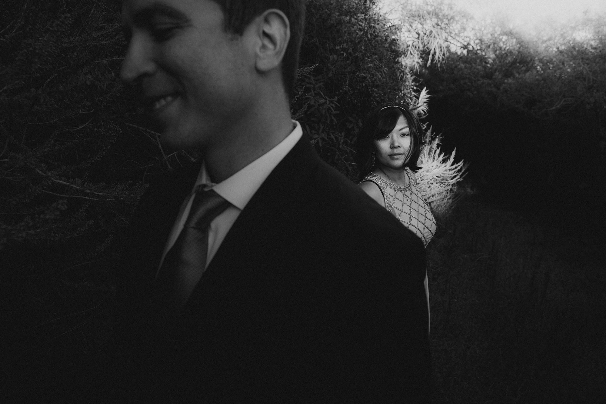 Moody black and white portrait of couple, by Jeff Newsom