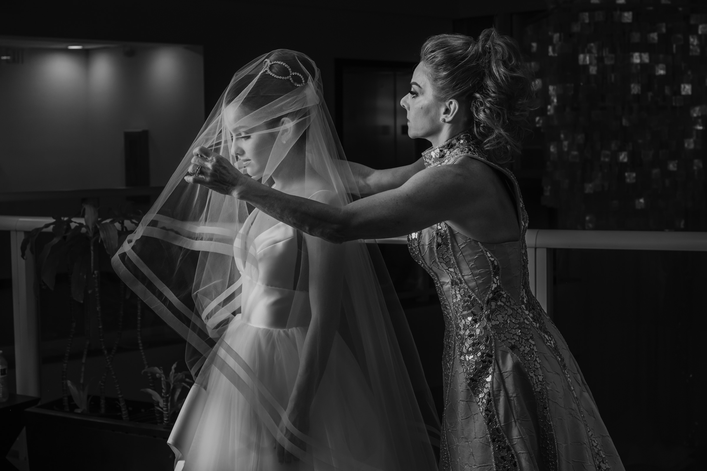 Mother adjusts her daughters veil - photo by El Marco Rojo