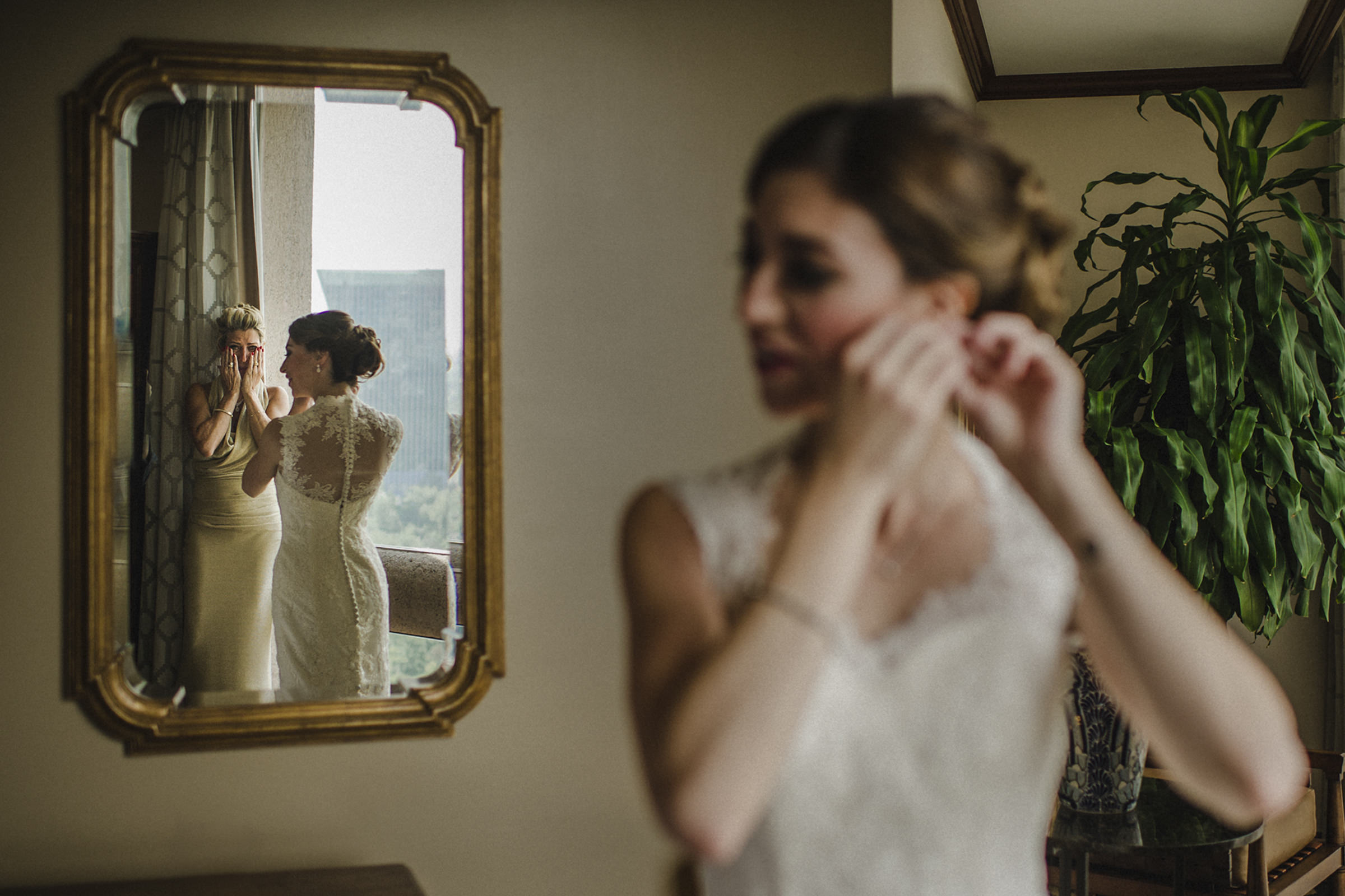 Mother chokes up watching bride put on earrings  - photo by El Marco Rojo