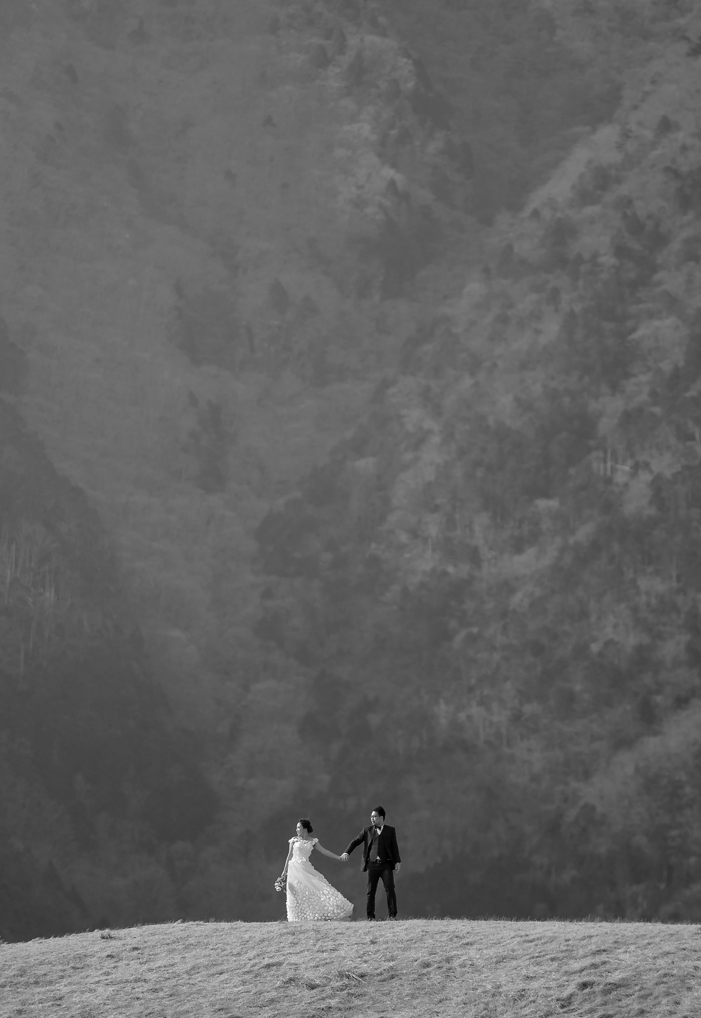 Mountaintop couple portrait - photo by 37 Frames