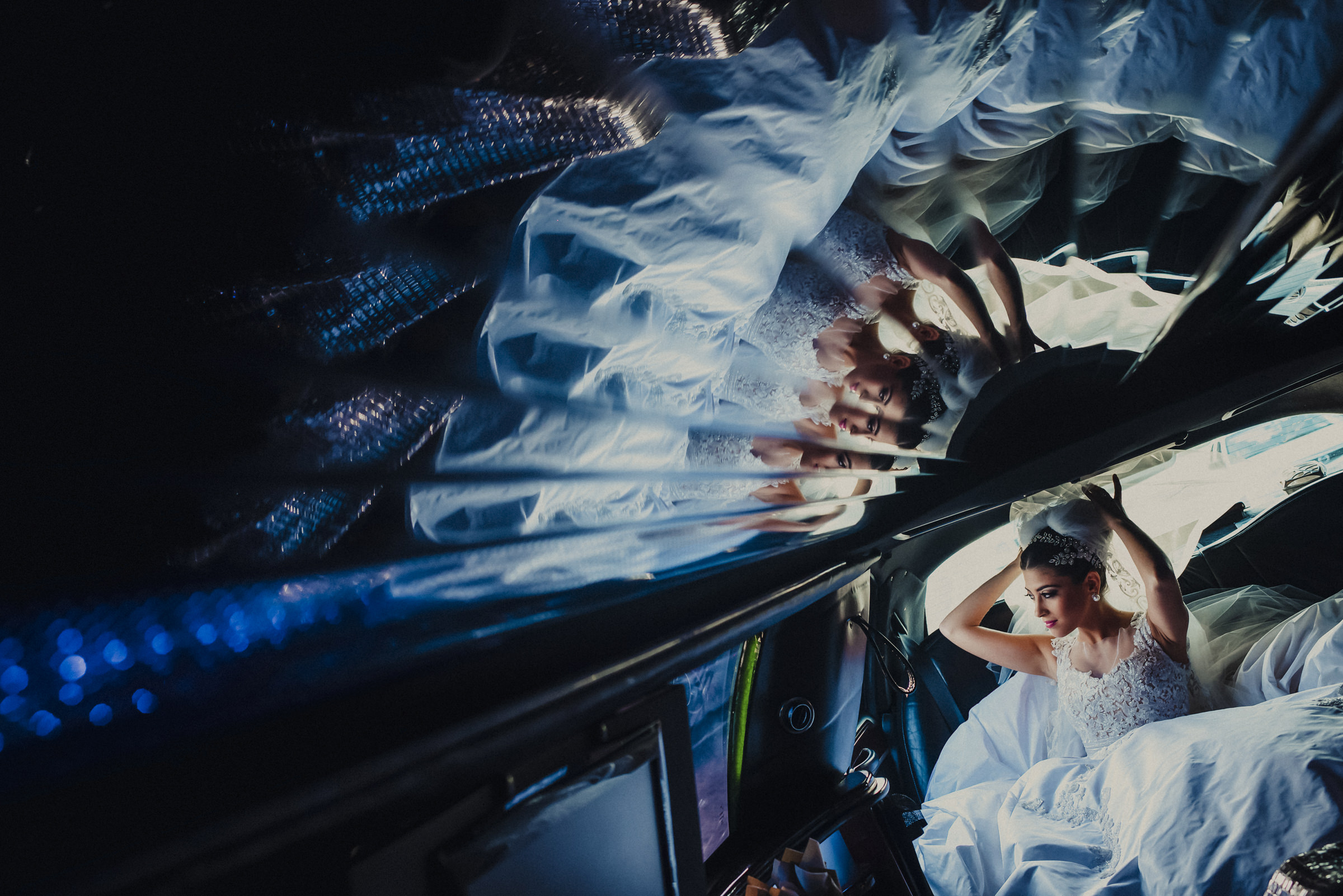Multiple reflections of bride on limo ceiling - photo by El Marco Rojo