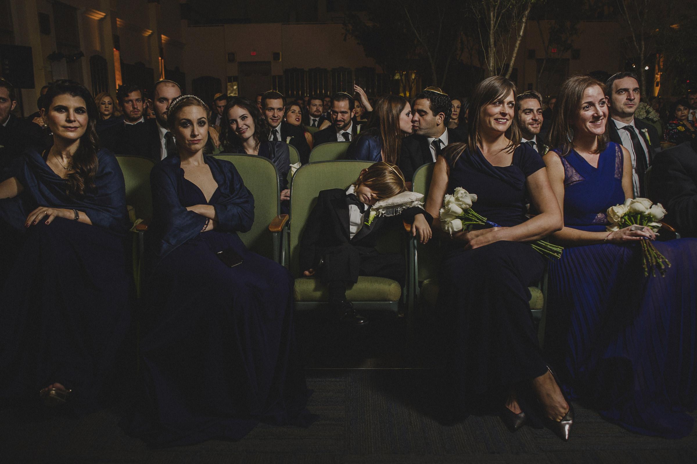 Ringbearer sleeps in front row of wedding ceremony - photo by El Marco Rojo