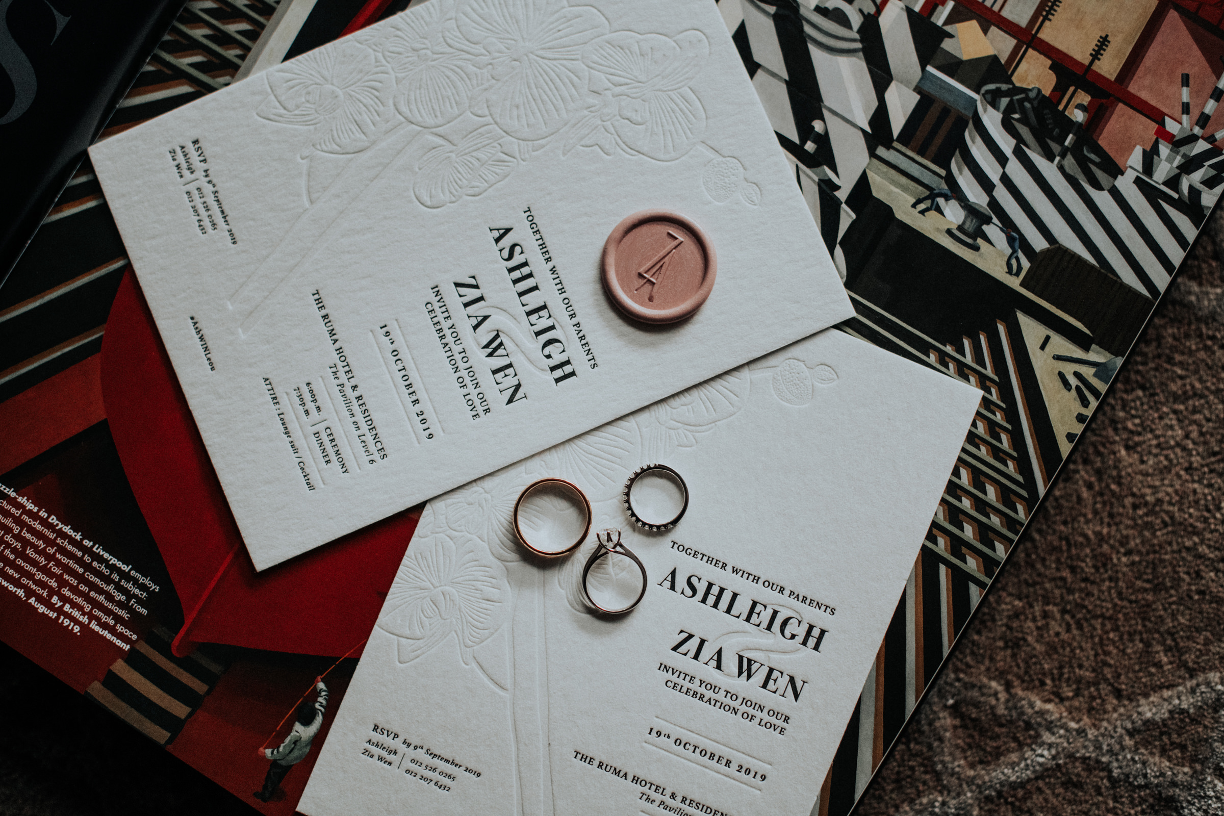 Flatlay of rings and wedding stationery - Photo by MunKeat Photography Studio
