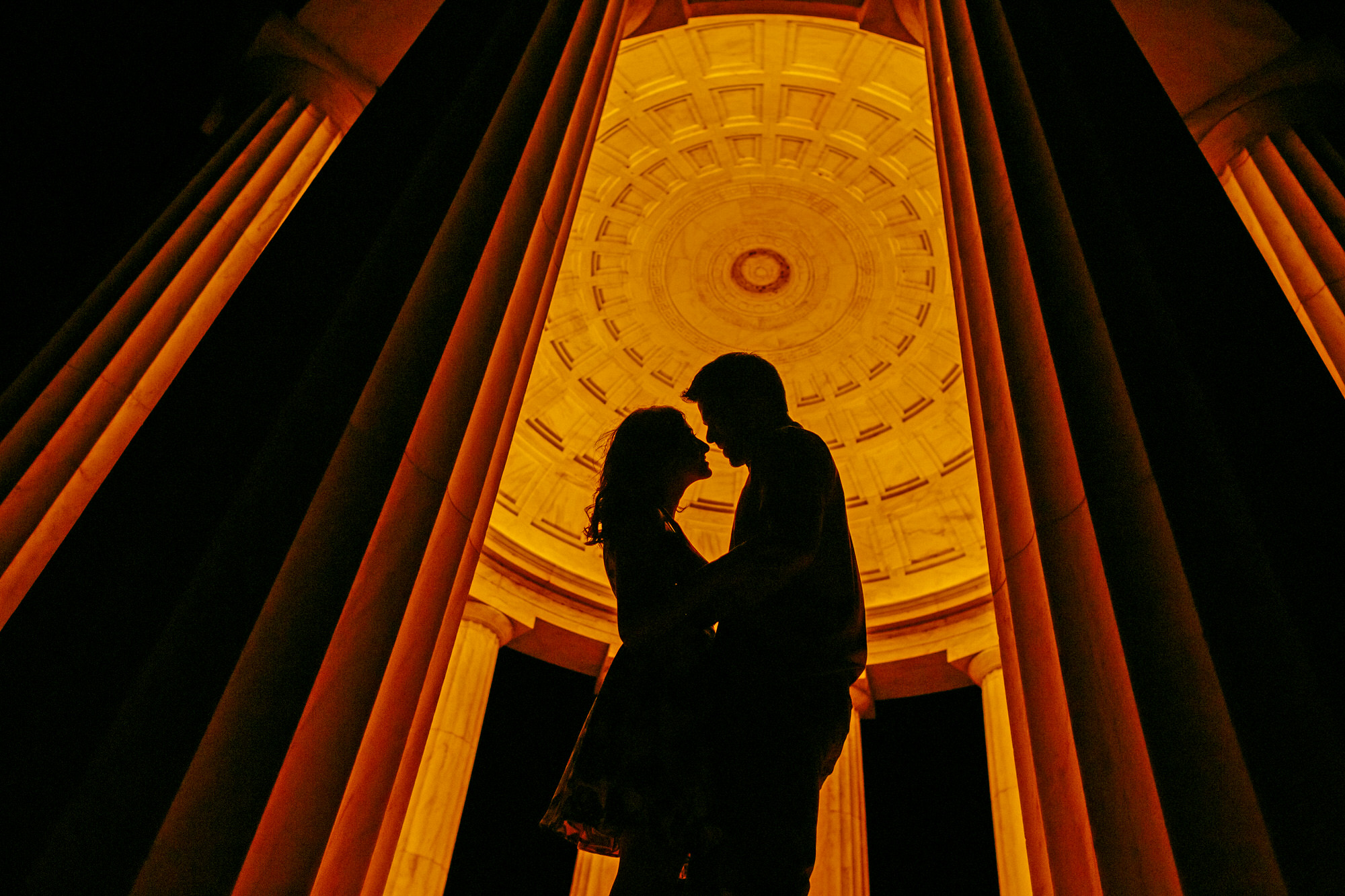 Silhouette of couple within classical structure -  photo by Ken Park