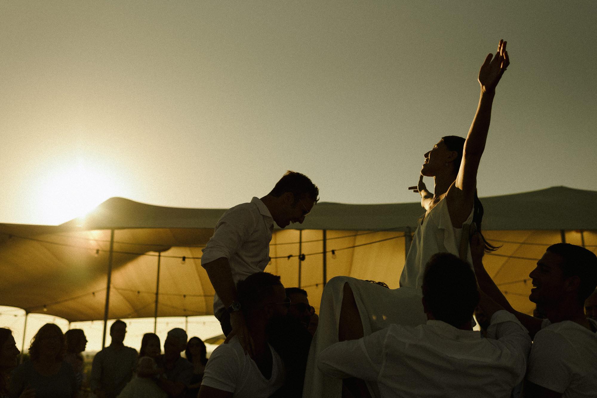 Joyful horah at sunset, photo by Thierry Joubert