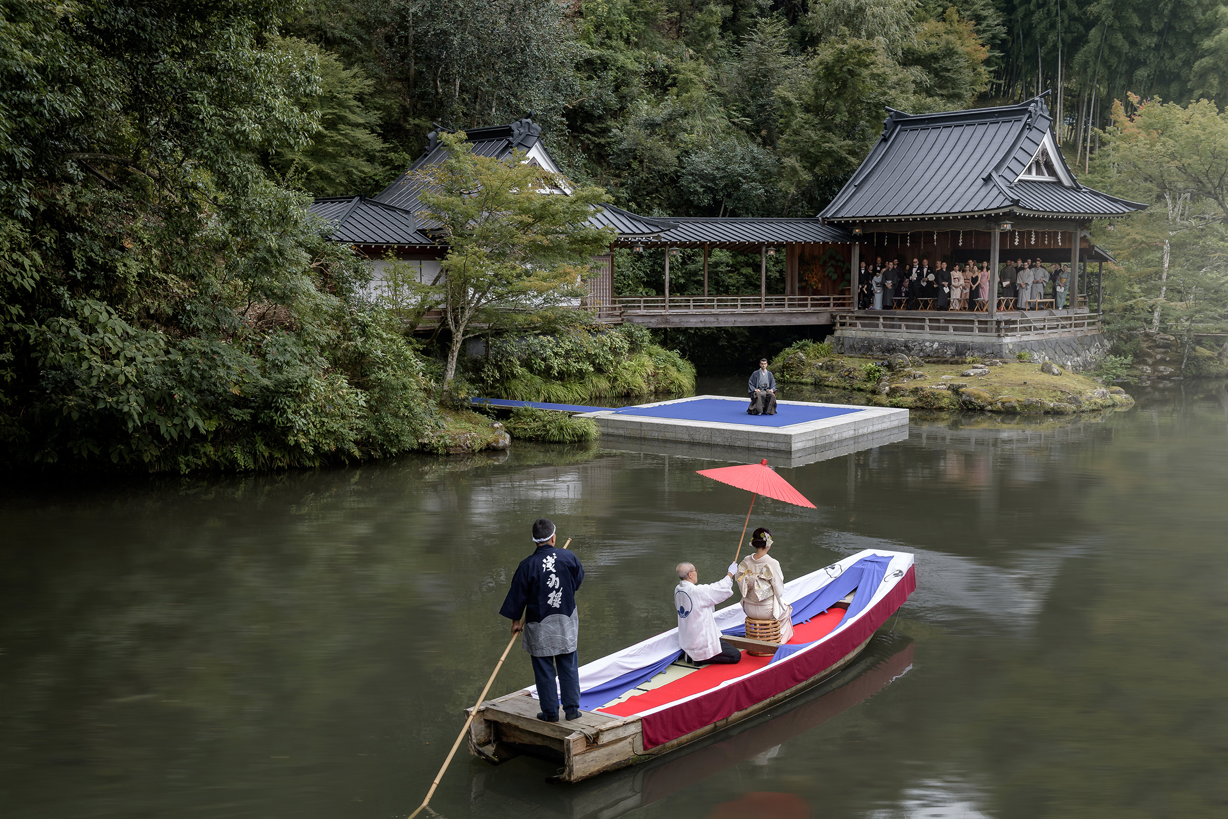Traditional bride boat being paddled to waiting groom - photo by 37 Frames