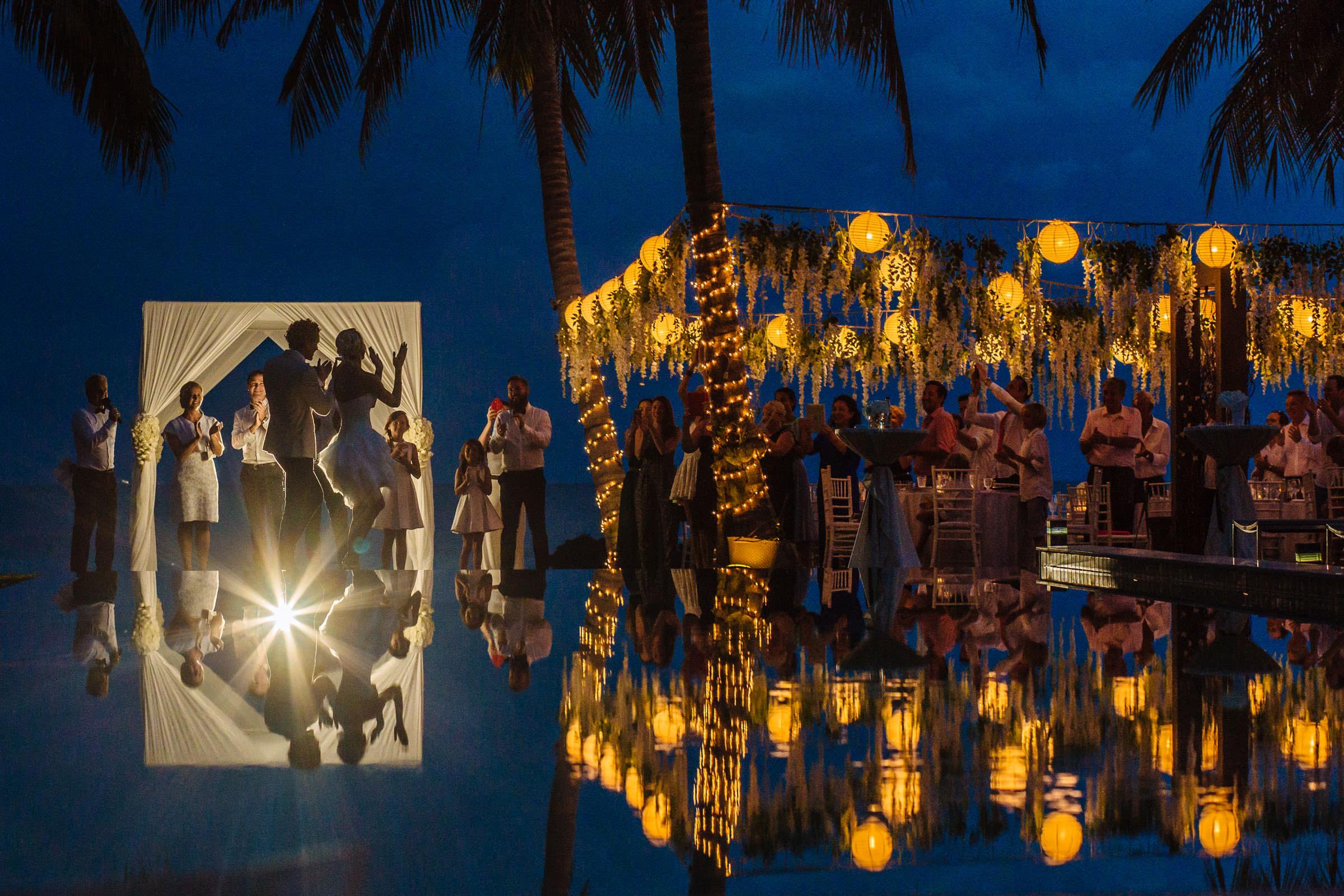 tropical reception by lantern light - Photo by Wainwright Weddings