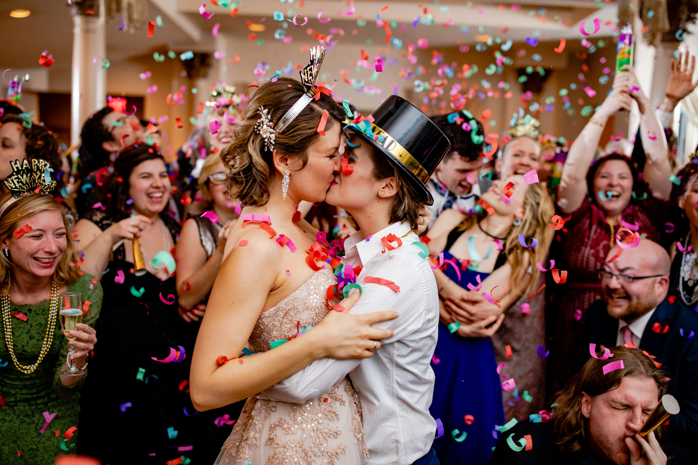 two brides kiss under confetti - New Year's eve wedding photo by Bee Two Sweet